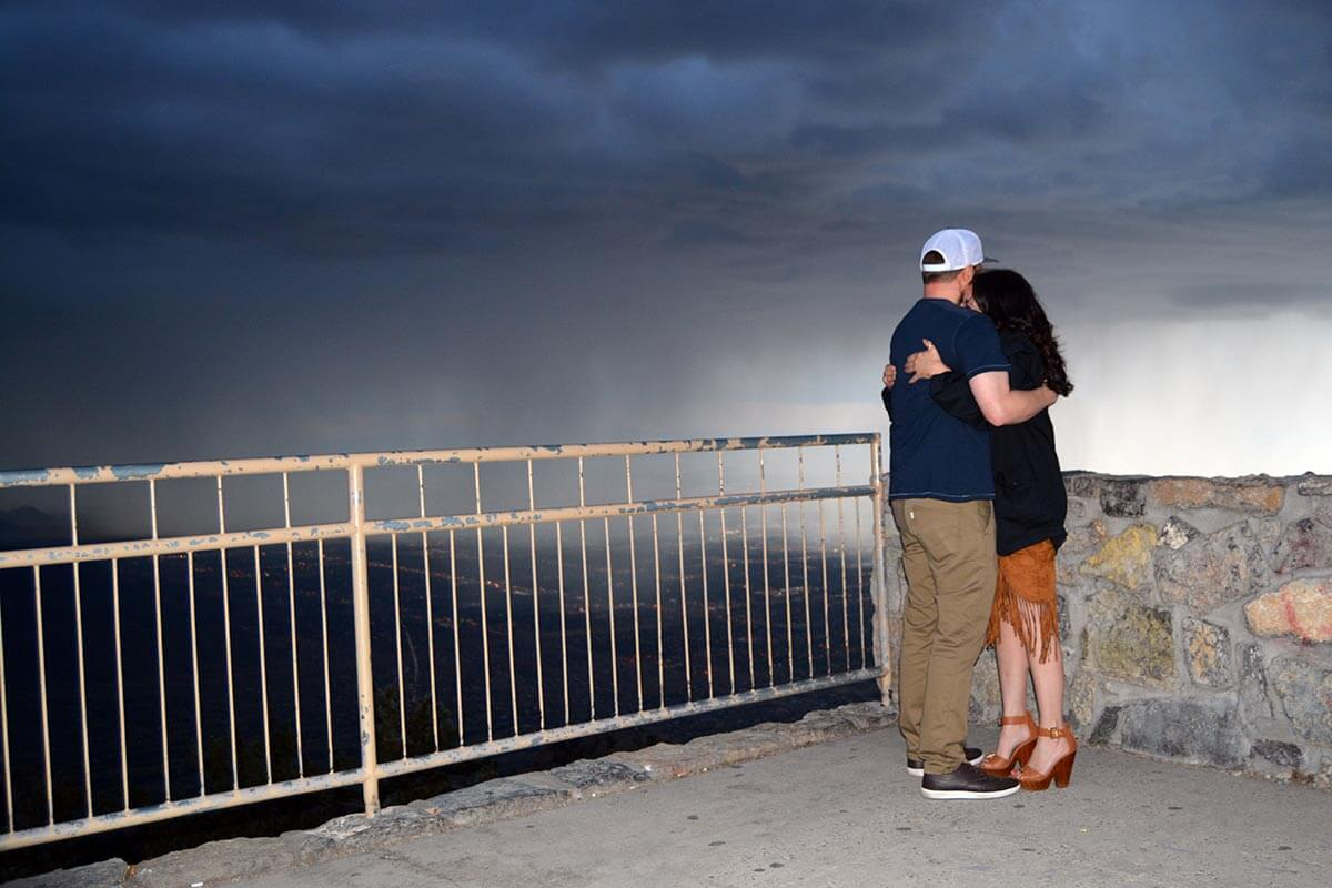 a couple hugging on a stormy evening on the Sandia Mountains in Albuquerque