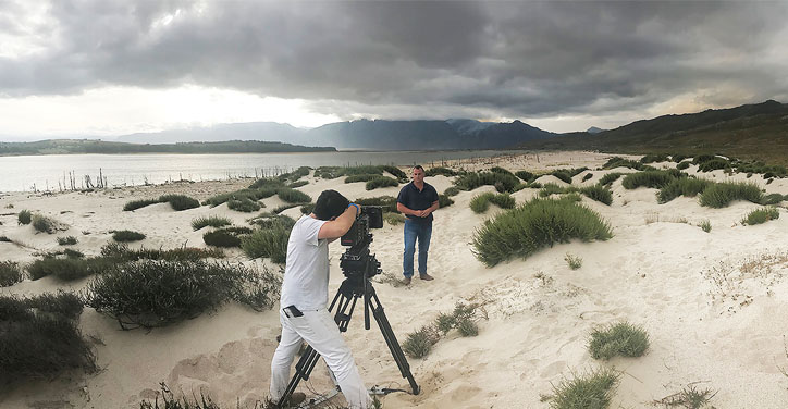 man being filmed on beach