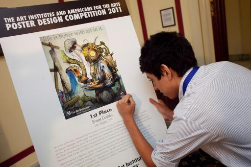 2011 Poster Design Competition Grand Prize Winner Signing His Poster