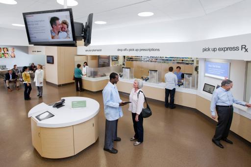 Walgreens pharmacists assisting local customers