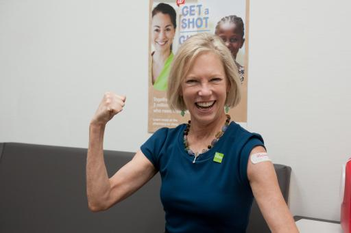 Kathy Calvin, President and CEO of the UN Foundation, receiving her flu shot