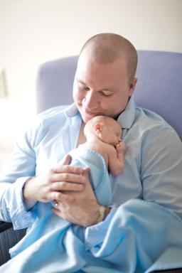 Father Holds Premature Baby