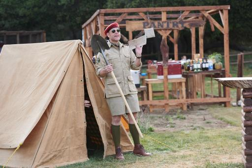 Host Alton Brown explains a challenge on Food Network's Camp Cutthroat