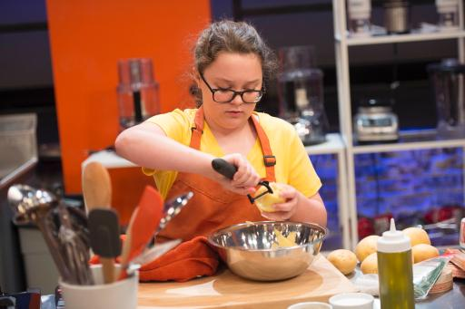 Kidtestant Sabrina competes on Food Network's Rachael Ray's Kids Cook-Off