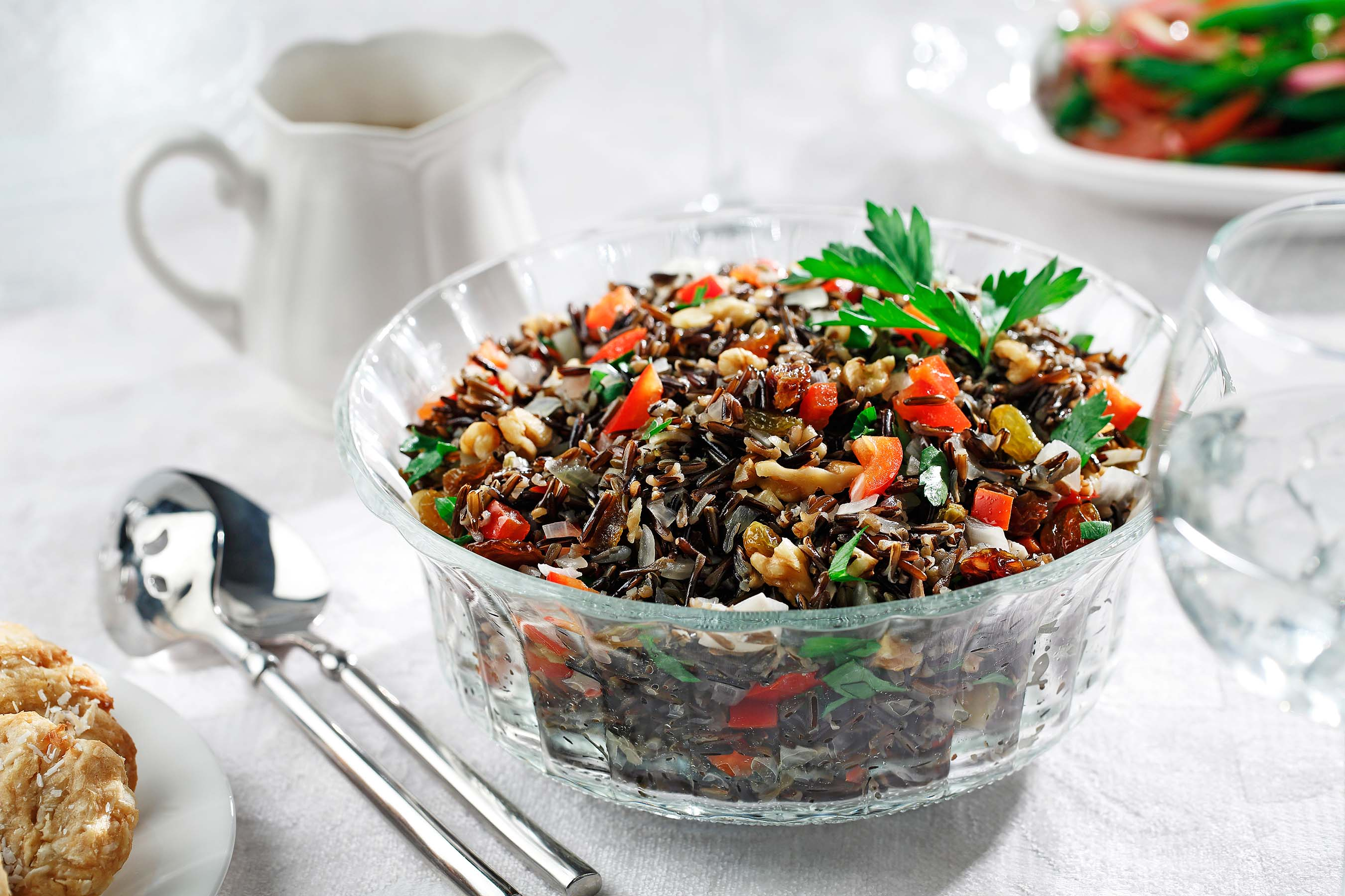 Using nutrient-packed wild rice with the Latin tastes of bell peppers, walnuts and raisins gives this dish a range of health benefits plus a rainbow of visual appeal. Canola oil helps the flavors meld.