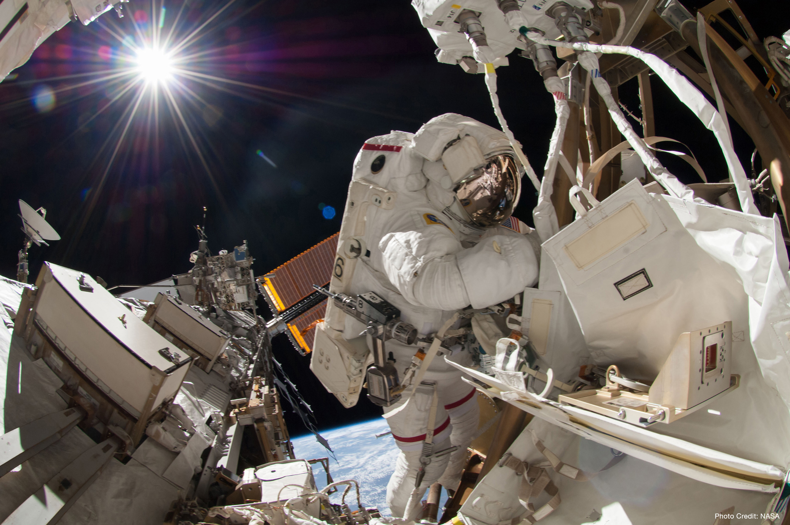 NASA astronaut Reid Wiseman, Expedition 41 flight engineer, participates in a spacewalk, performing maintenance on the International Space Station. Photo credit: NASA.