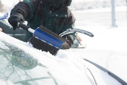 Clearing snow from car