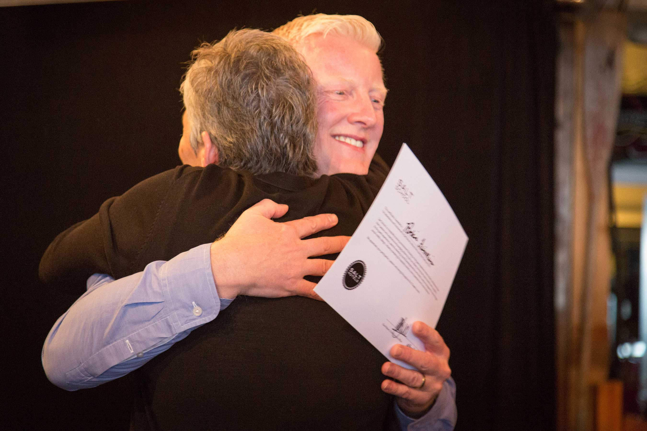 David Bowd awards a Salt School student her diploma