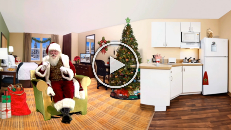 """Santa Claus and Extended Stay America, """"Santa's Official Hotel,"""" Partner to ease holiday travel woes. In time for the holiday season, the ultimate holiday travel guru shares holiday travel tips."""