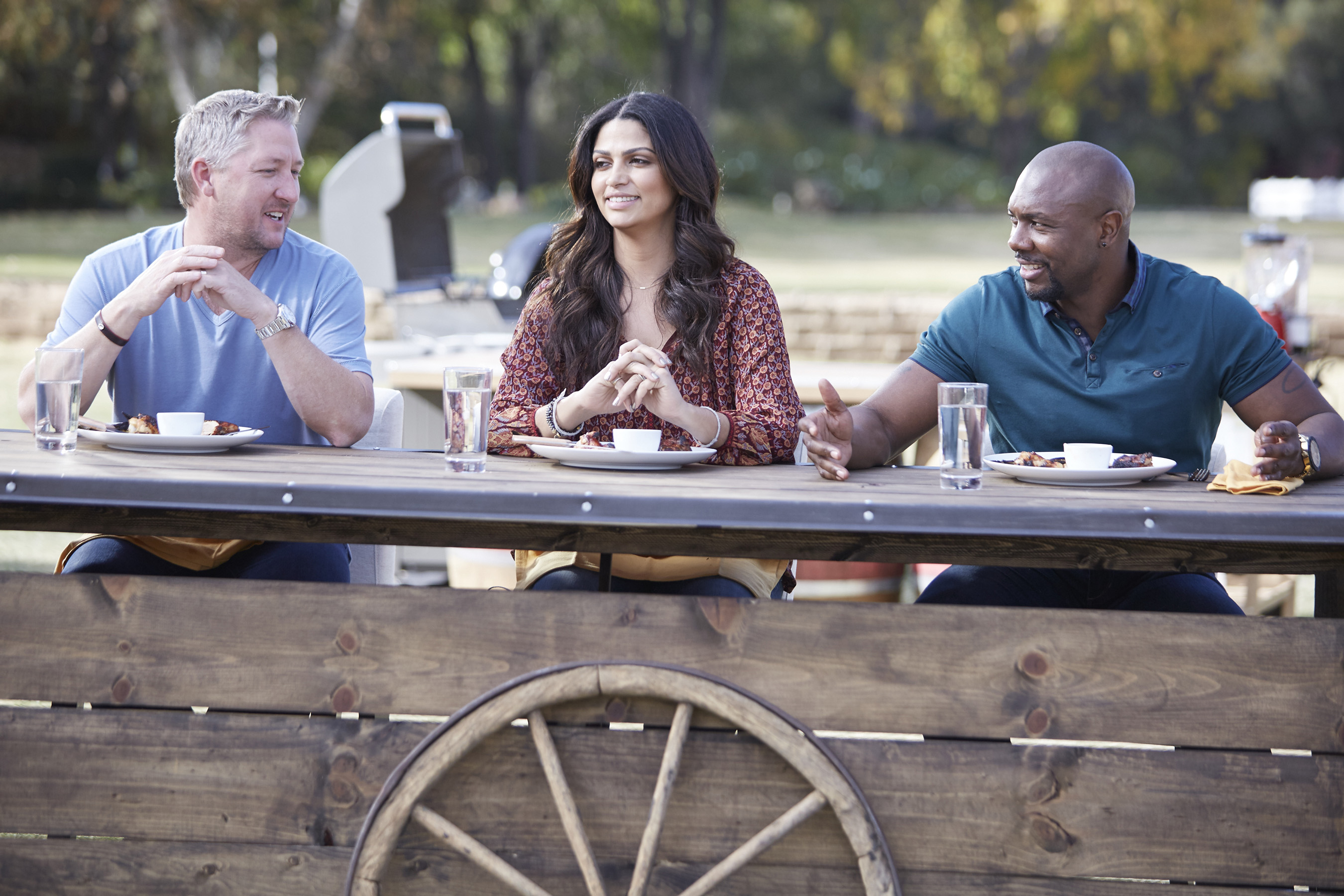 Guest Judge Tim Love with Hosts Camila Alves and Eddie Jackson on Food Network's Kids BBQ Championship