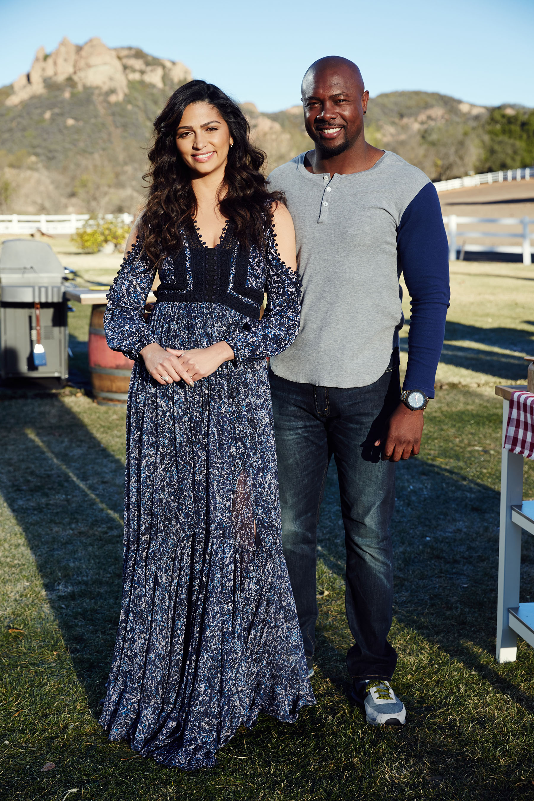 Hosts Eddie Jackson and Camila Alves on Food Network's Kids BBQ Championship