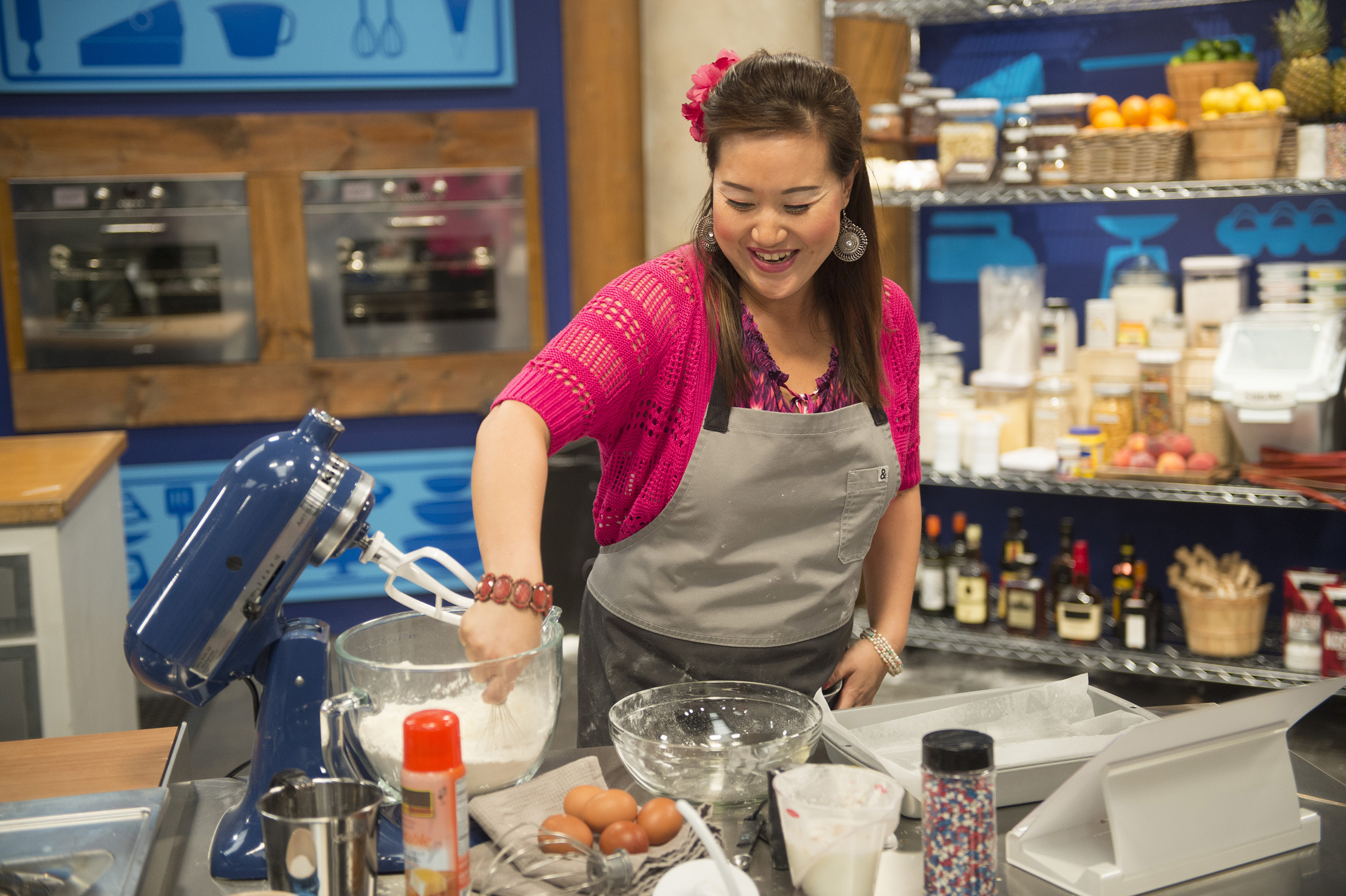 Competitor Lizzy Lu works to complete her dish on Food Network's Worst Bakers in America