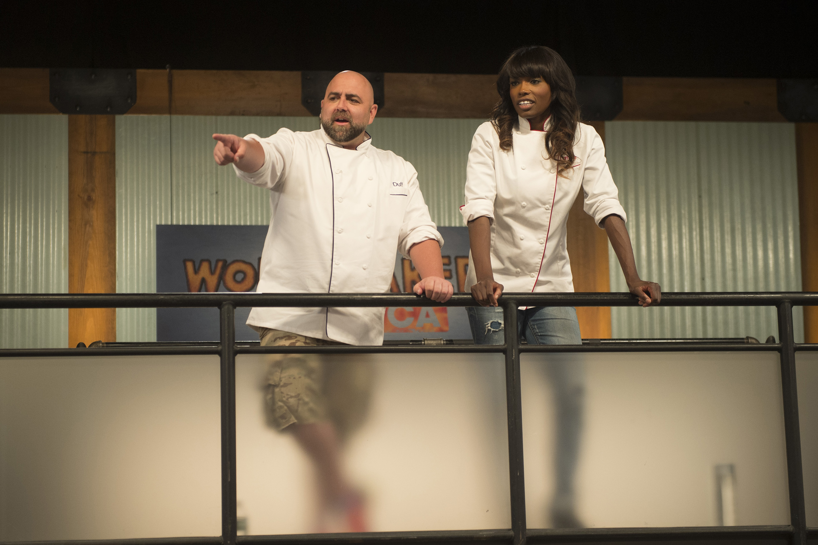 Hosts Duff Goldman and Lorraine Pascale watch the competitors on Food Network's Worst Cooks in America