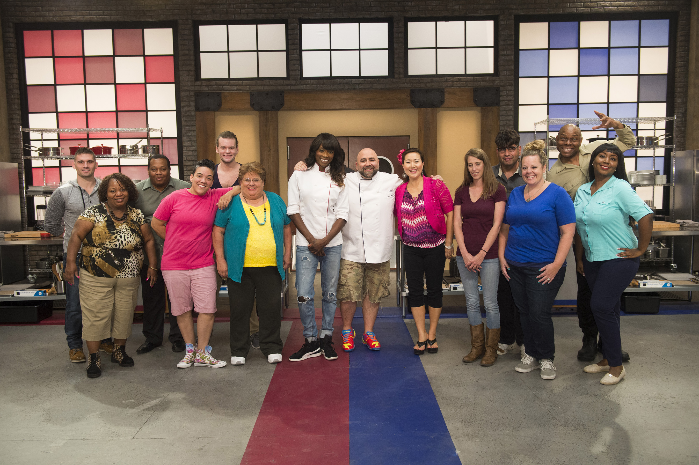 Hosts Duff Goldman and Lorraine Pascale with competitors (left to right) Ryan Neiman, Carla Johnson, Anthony Lee, Shante Randolph, Jesse Wyum, Judy Welch, Lizzy Lu, Samantha Brown, David Rosenberg, Stephanie Garcia, Carey Westbrook, and Kimberly Worthy on Food Network's Worst Bakers in America