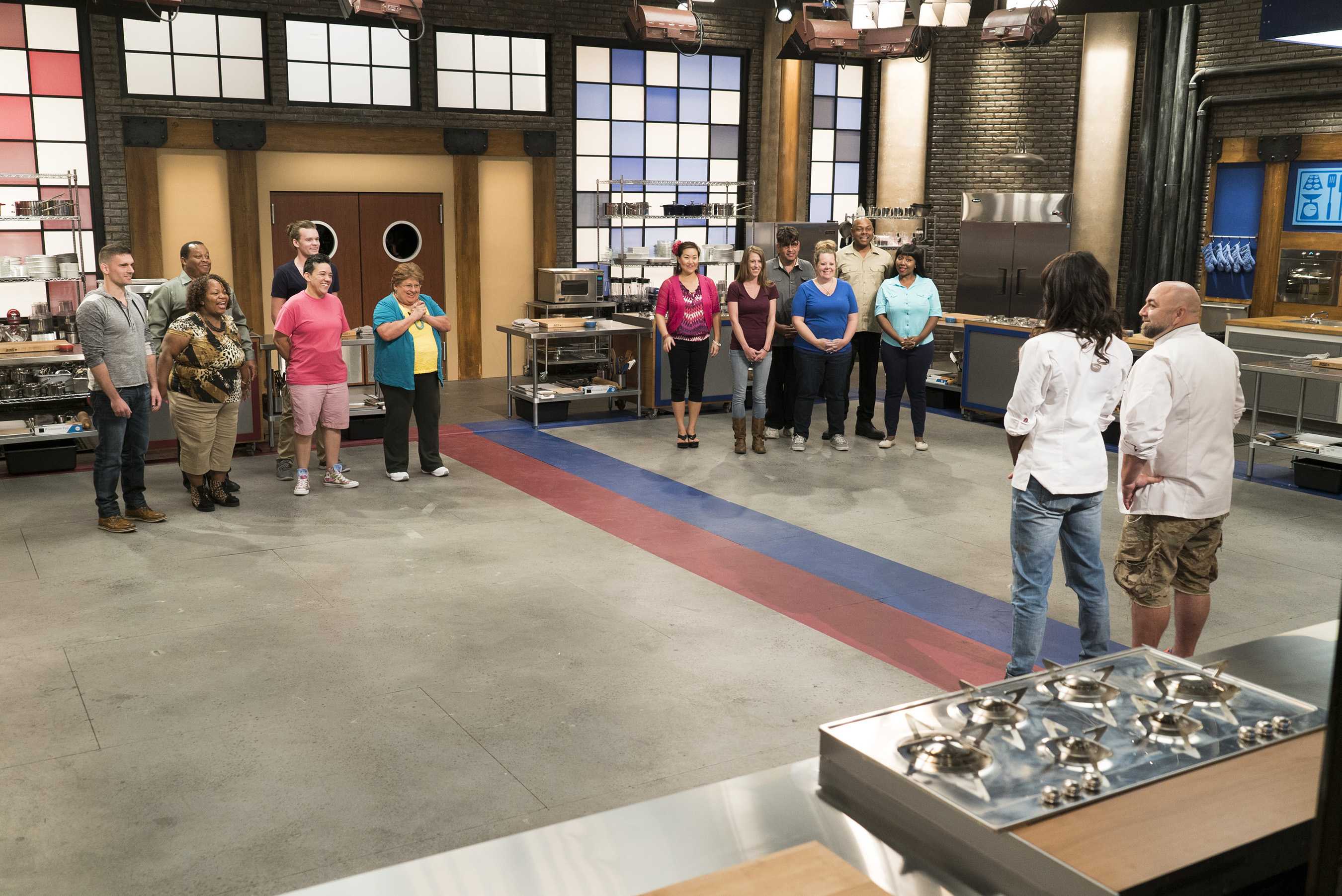 Hosts Duff Goldman and Lorraine Pascale with competitors on Food Network's Worst Bakers in America