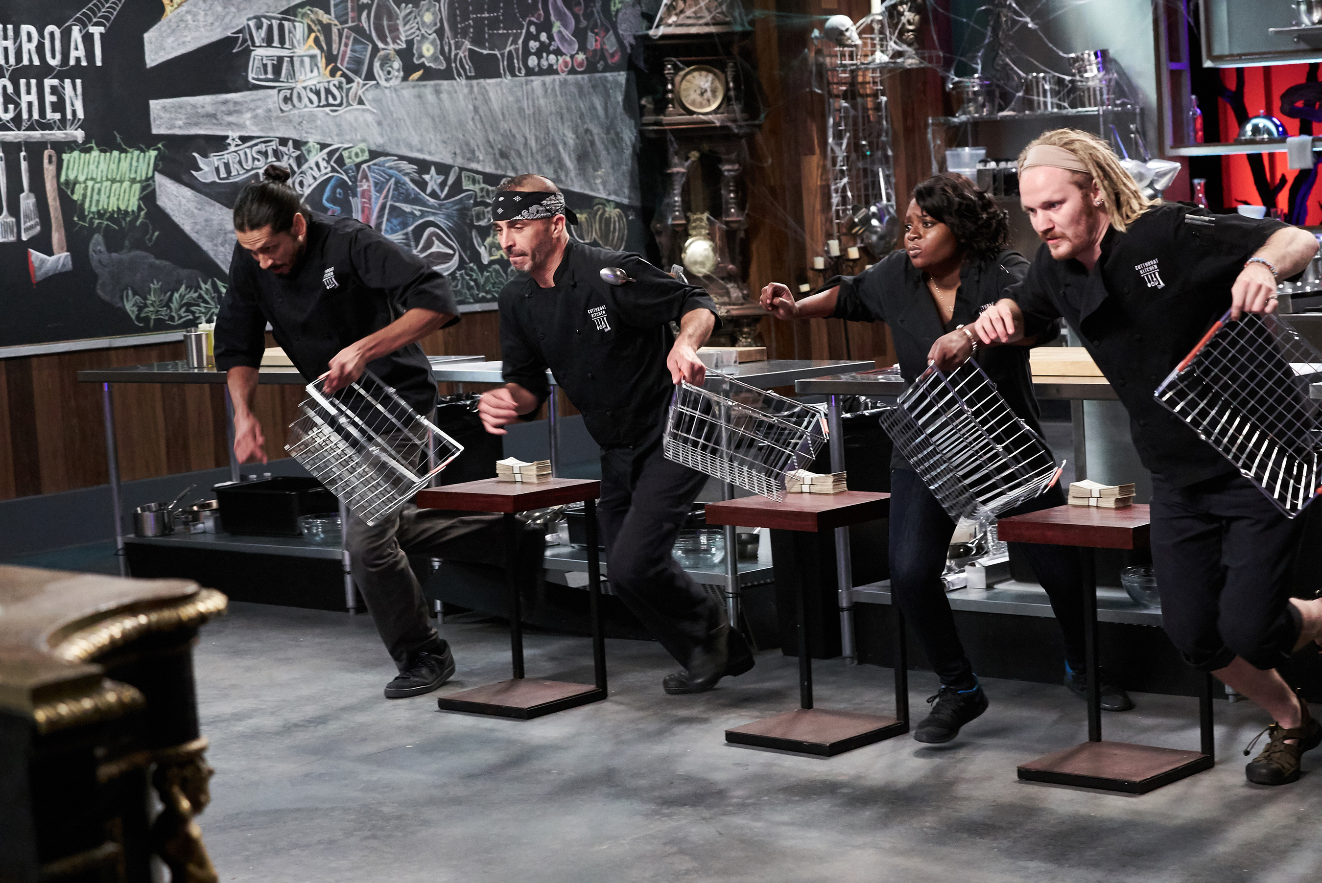 Contestants Osvaldo Blackaller, Johnny Messina, Tiffany Ermon and Chase Meneely on Food Network's Cutthroat Kitchen: Tournament of Terror