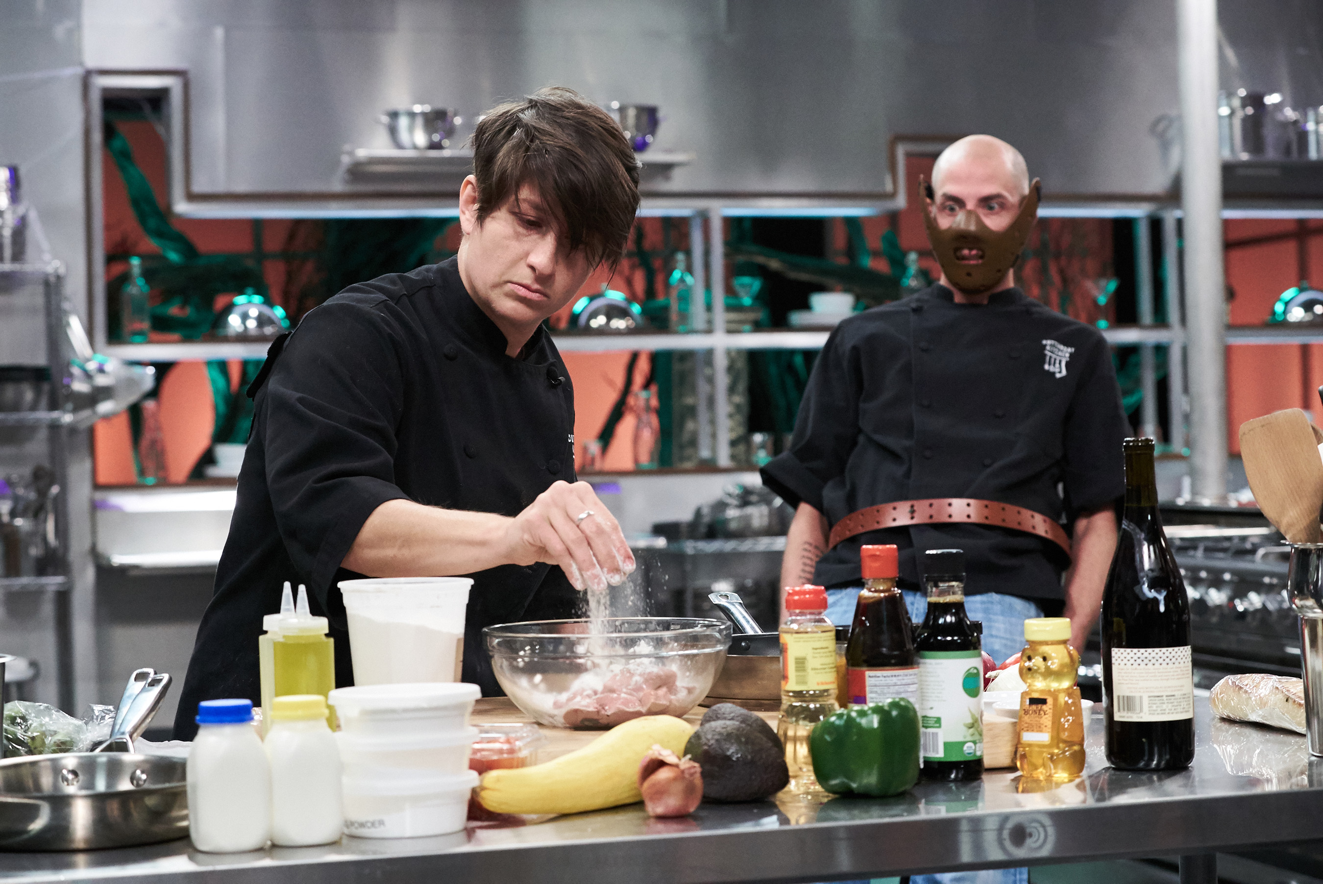 Contestants Rouha Sadighi and Trevor McGrath on Food Network's Cutthroat Kitchen: Tournament of Terror