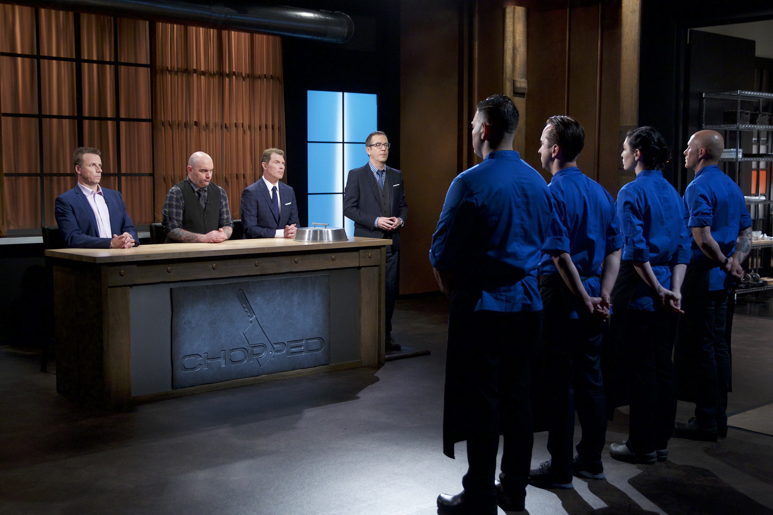 Judges Marc Murphy, Chris Santos and Bobby Flay with Host Ted Allen and competitors on Food Network's Chopped: Beat Bobby Flay