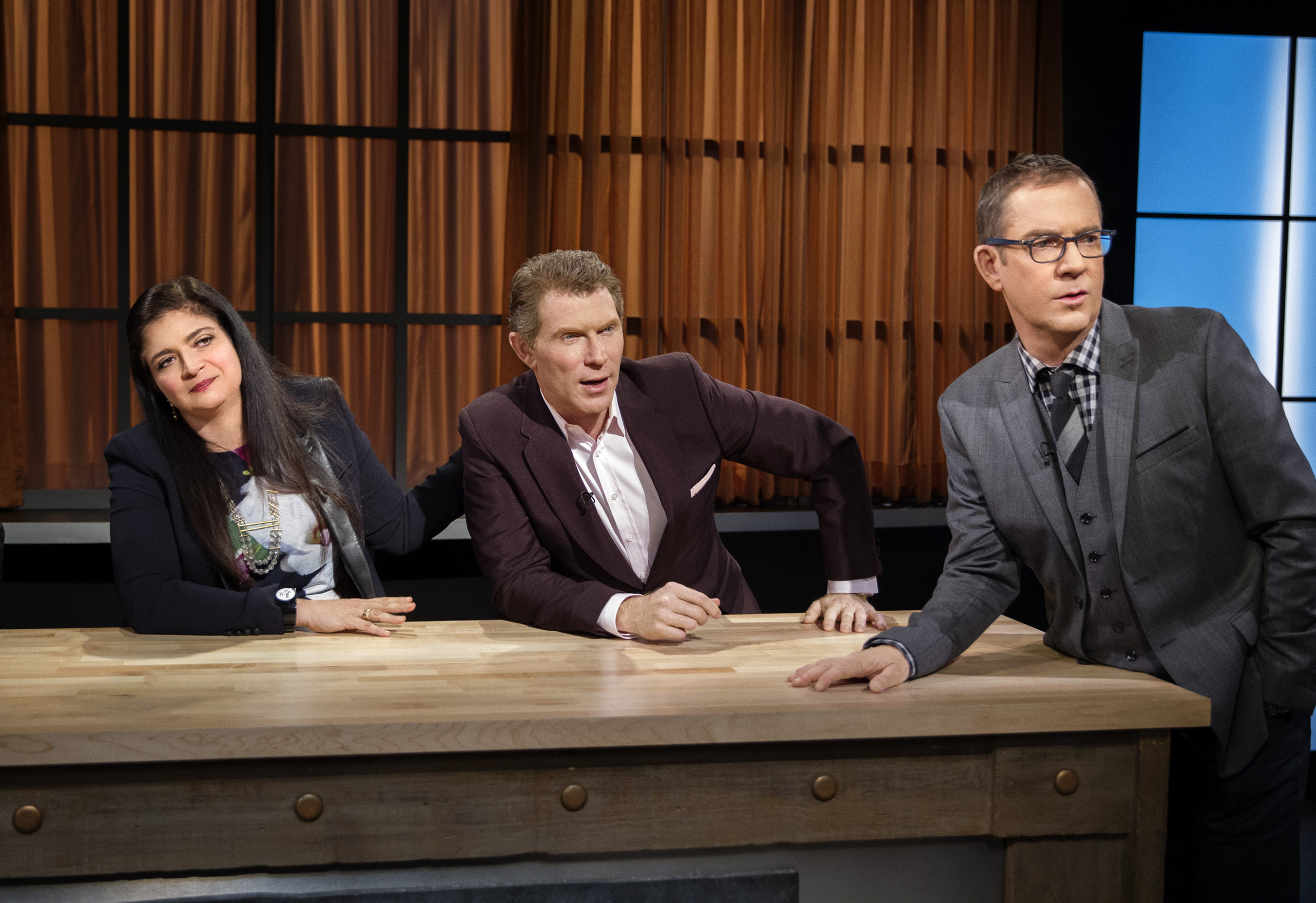 Judges Alex Guarnaschelli and Bobby Flay and host Ted Allen watch the competitors on Food Network's Chopped: Beat Bobby Flay