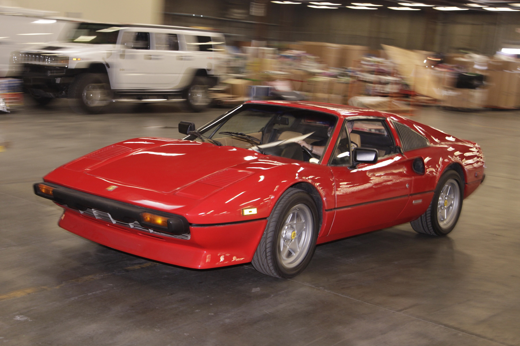 A California Highway Patrol Officer drives the stolen 1981 Ferrari at the Port of LA/Long Beach Customs warehouse.