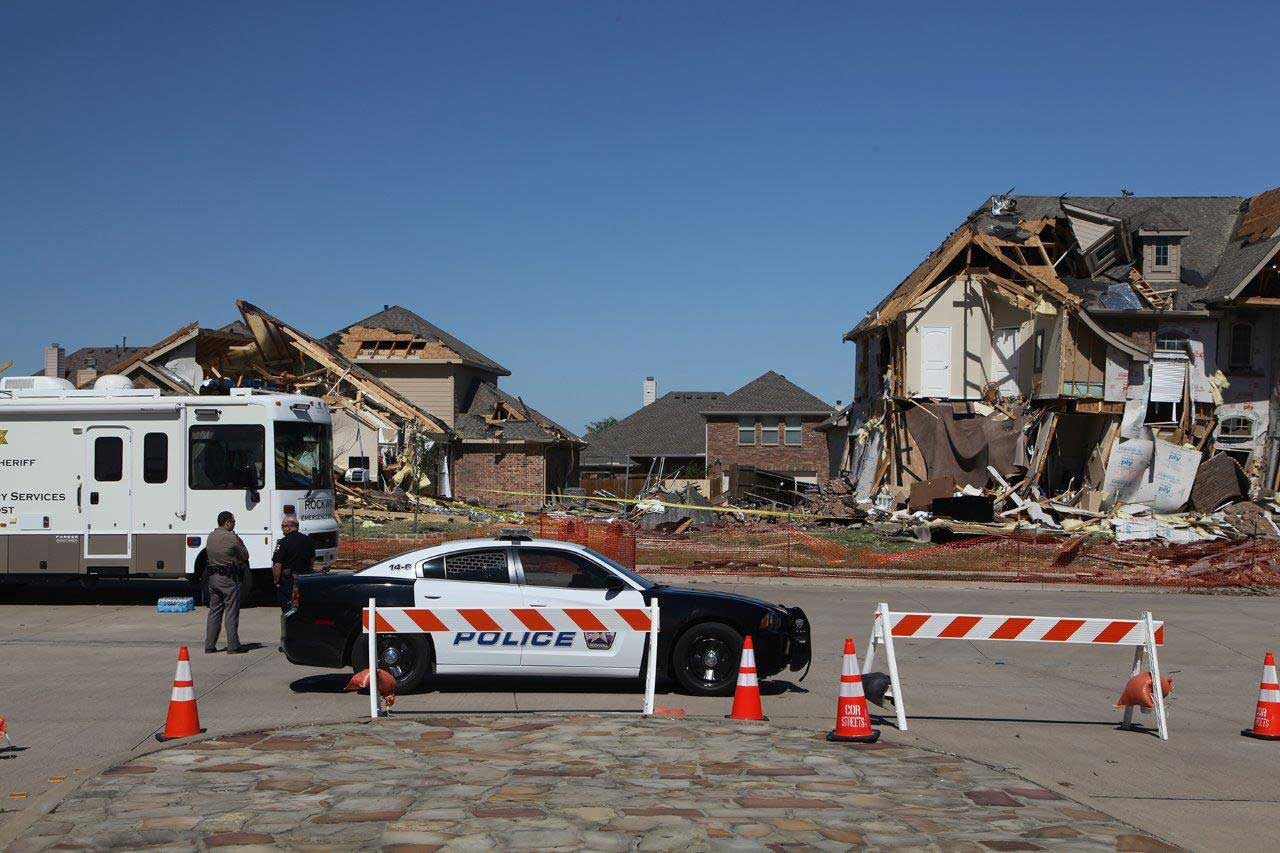 Heavily damaged areas in the city of Rockwall were cordoned off by police to keep potential scam artists from going door-to-door to solicit repair work.
