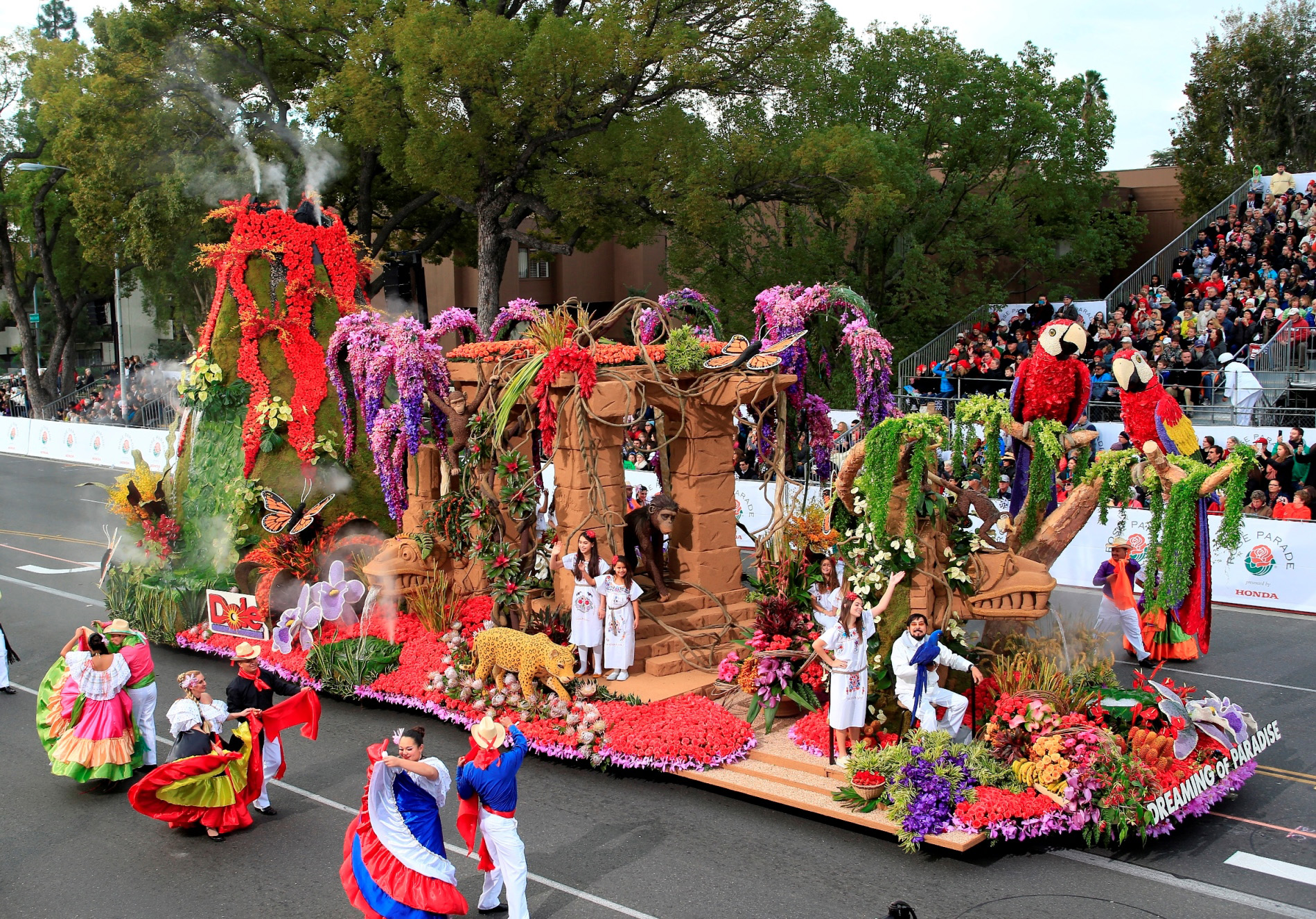 "Dole's 2013 entry, ""Dreaming of Paradise,"" honored independent family farmers and paid tribute to the beauty of Latin America. Designer Raul R. Rodriguez rode this float with his pet Macaw, Sebastian."