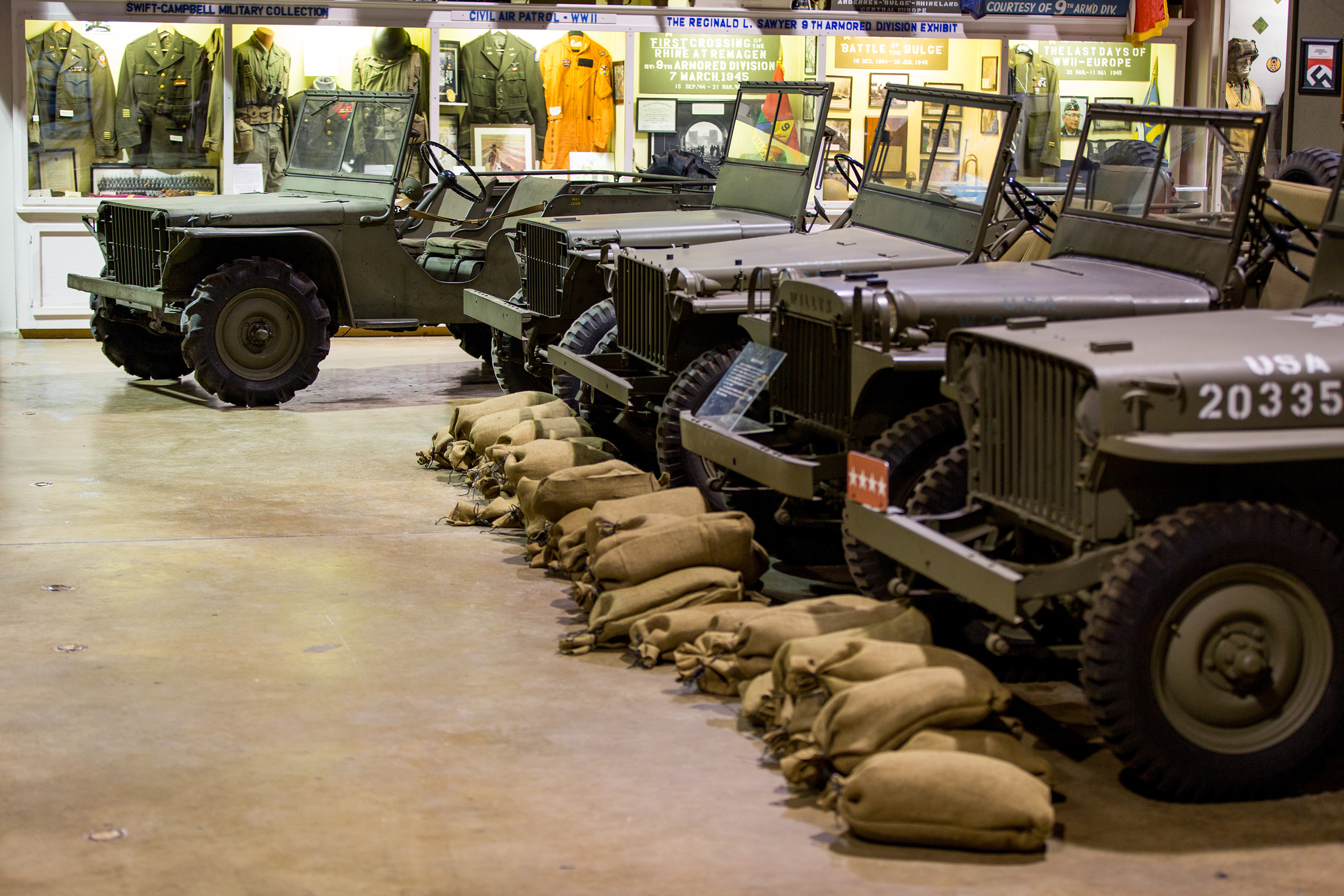 """The 1940 Ford Pilot Model GP-No. 1 Pygmy is placed at the head of a row of rare and early """"jeeps"""" at the U.S. Veterans Memorial Museum, illustrating the vehicle's lineage. From left to right: 1941 Ford GP (serial no. 9911), 1941 Bantam BRC (serial no: 1208), 1941 Willys MA (serial no. 85504), and 1941 Willys MB """"Slat Grill"""" (serial no. 102157 and serial no. 105312). (Photo courtesy of the Historic Vehicle Association/Casey Maxon)"""