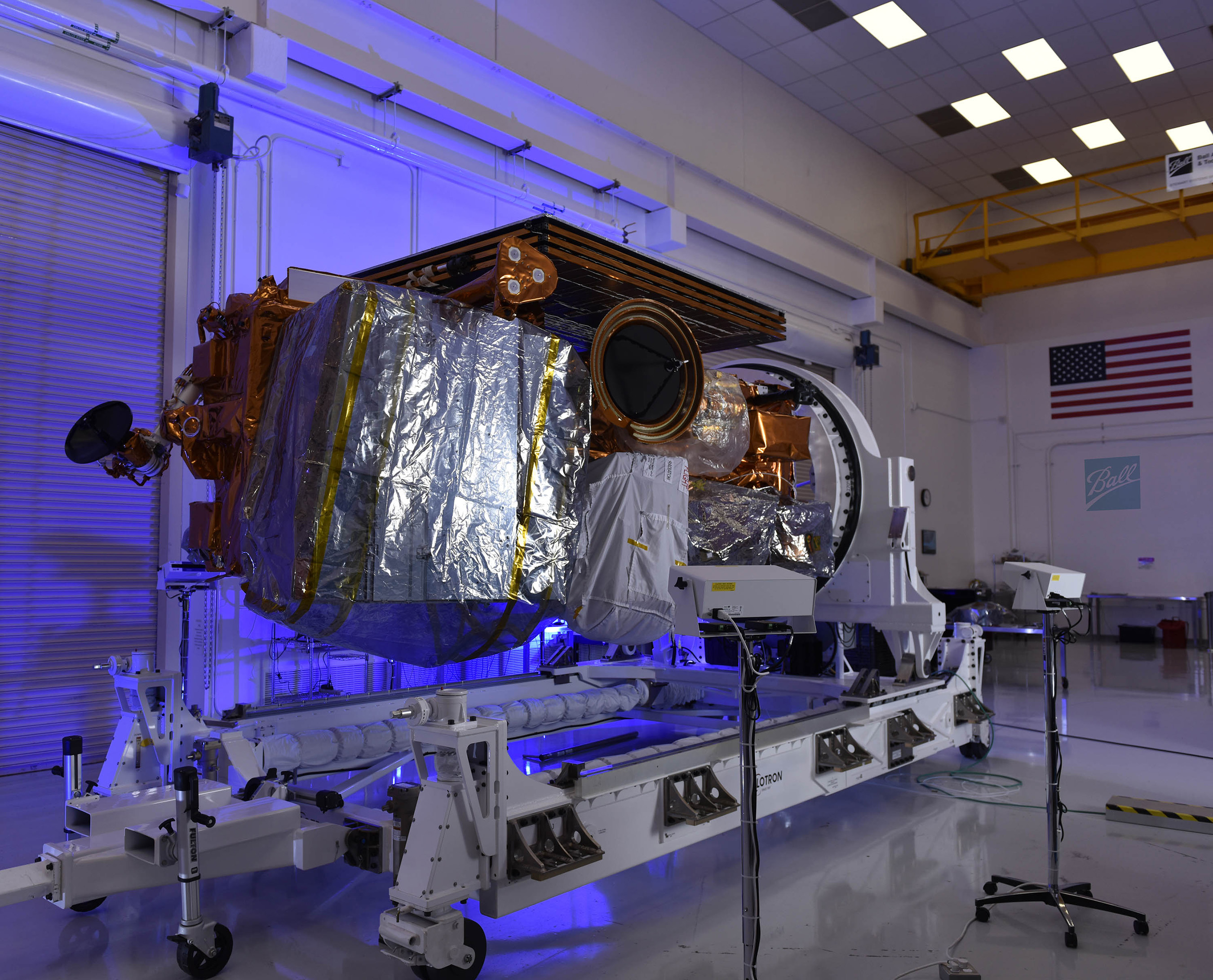 The completed JPSS-1 satellite, shown here with its five integrated instruments in the cleanroom at Ball Aerospace, Boulder, Colo., is ready for shipment to Vandenberg Air Force Base for final launch preparations. CREDIT: Ball Aerospace