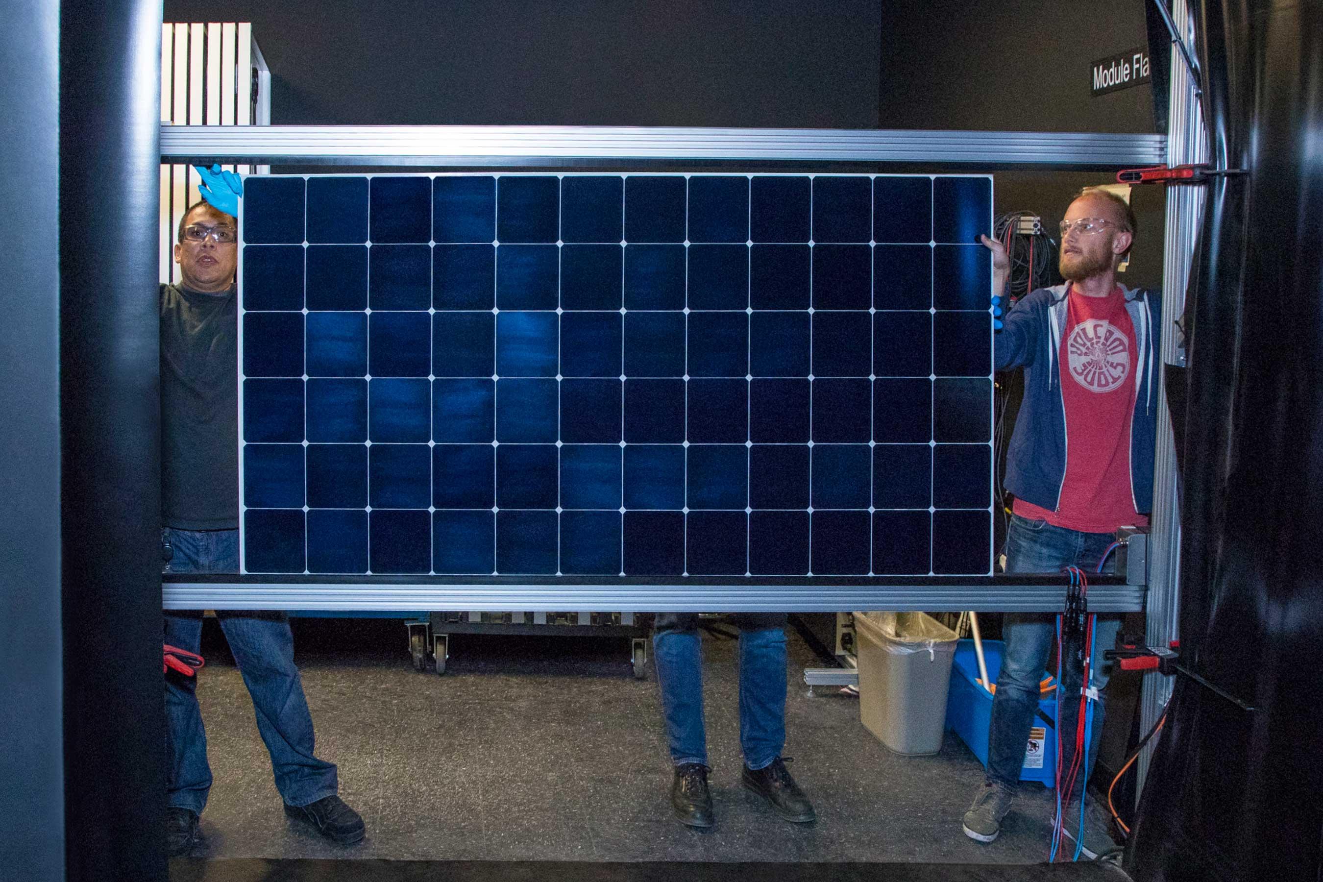 A SunPower module comes off a flash tester in California.