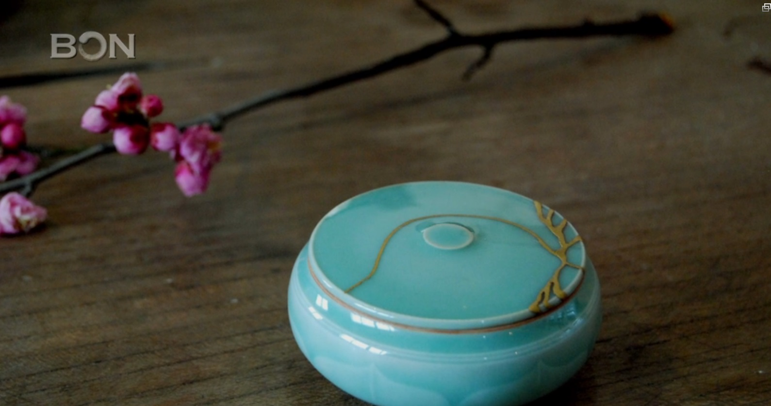A celadon dish repaired with gold by Deng Bing. The art of Jin Shan uses a philosophy of embracing the flawed or imperfect.