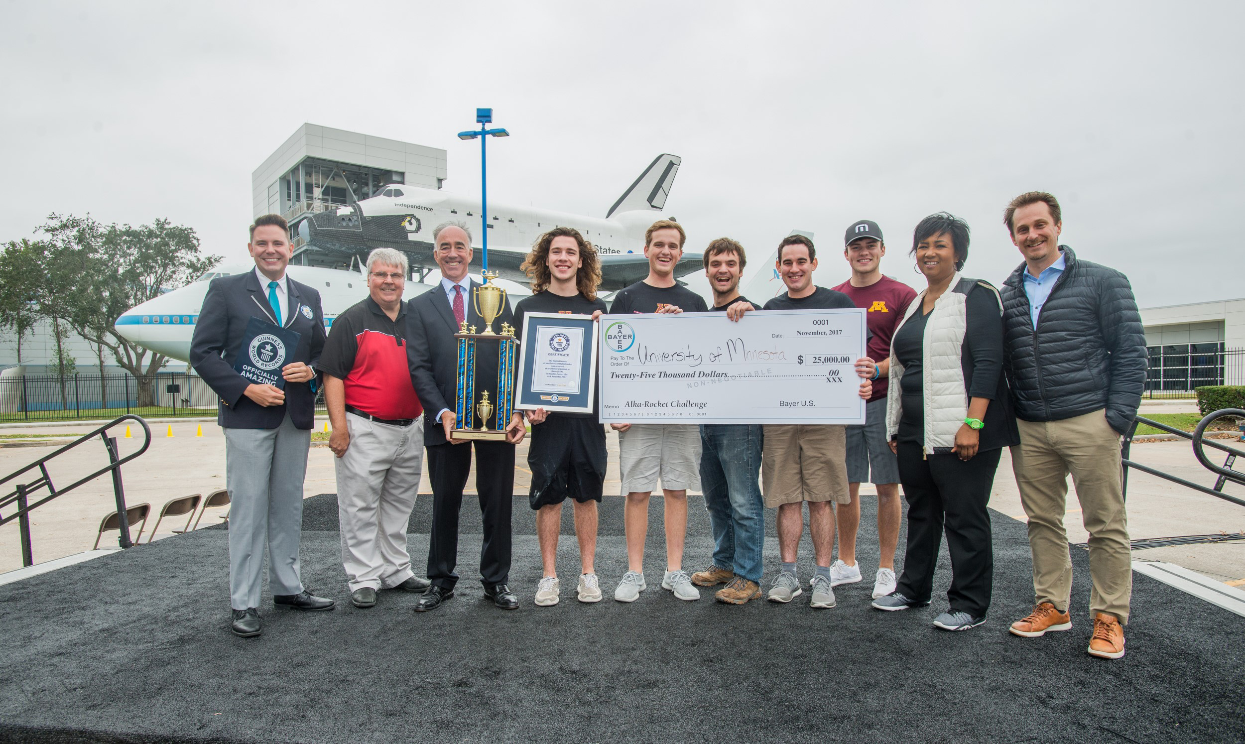 University of Minnesota students accept the winning prize in the Bayer-Big Ten Alka-Rocket Challenge at Space Center Houston