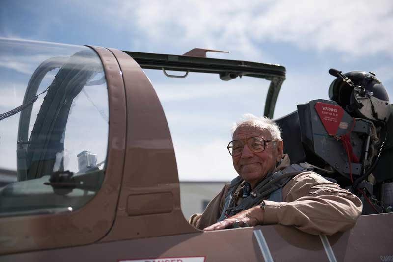 Jack Dorshaw, 97, sits ready in the cockpit of a fighter jet moments before he fulfilled his Wish of a Lifetime of piloting the aircraft.