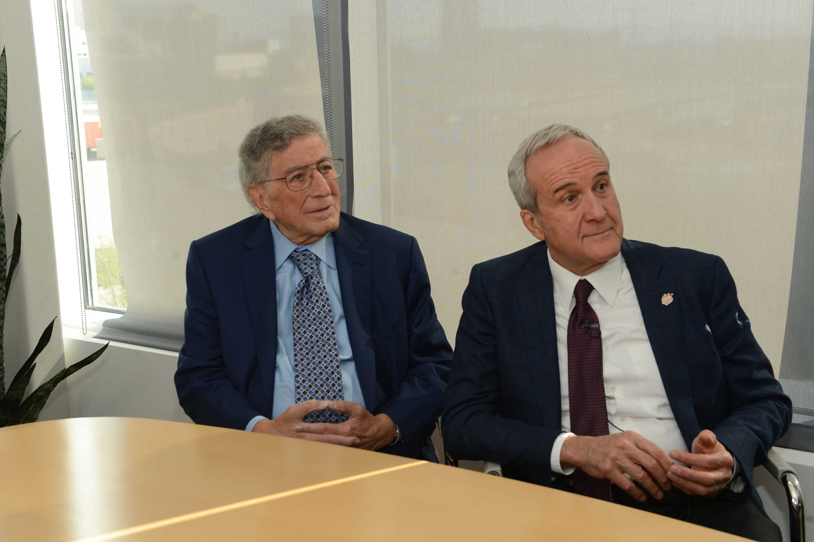2016 Power of Love gala honoree, Tony Bennett (L), and Keep Memory Alive founder Larry Ruvo (R) listen to a presentation by Director Dr. Cummings at Cleveland Clinic Lou Ruvo Center for Brain Health