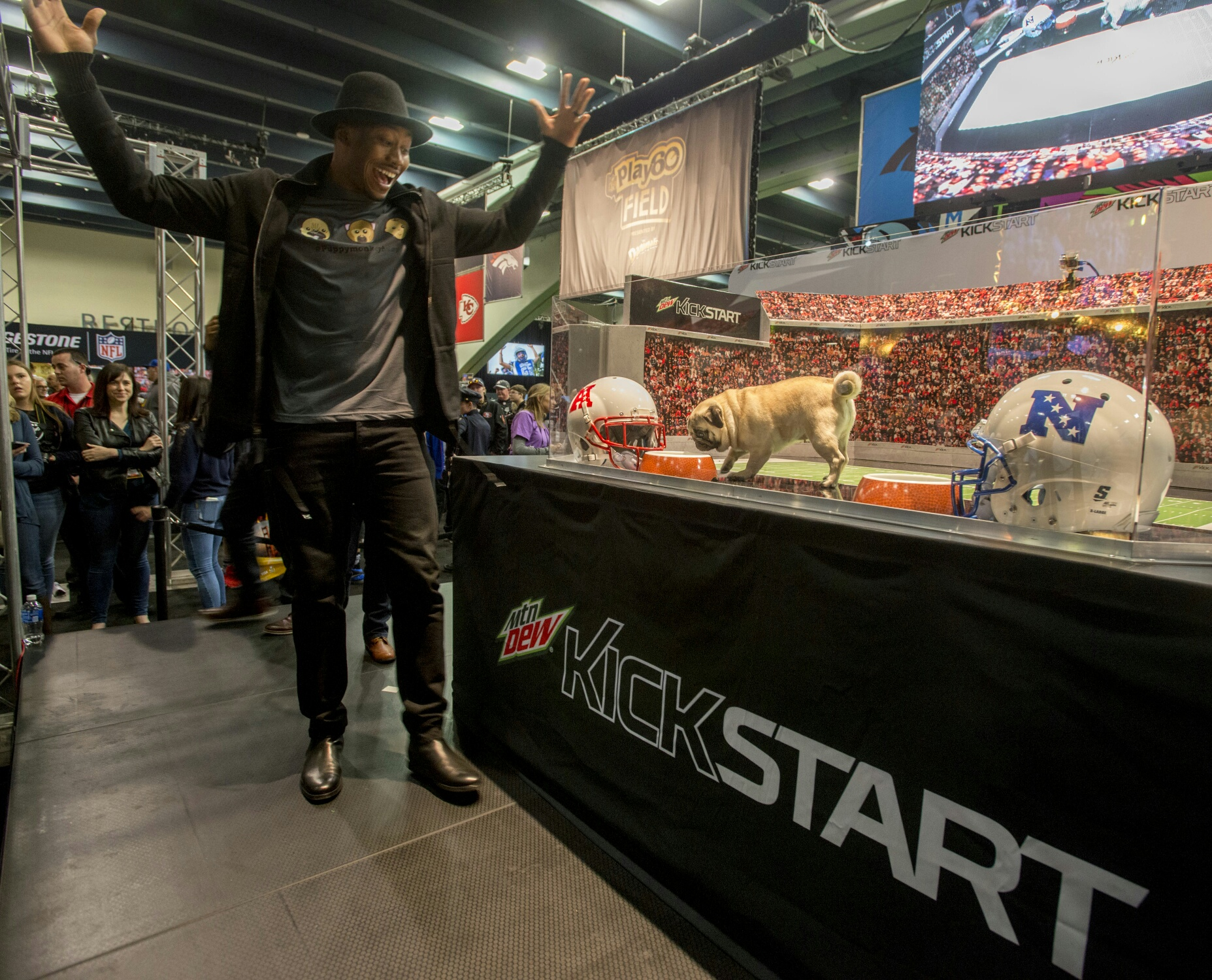 Star wide receiver Brandon Marshall moderates the MTN DEW® KICKSTART™ Super Bowl 50 predictions by a puppy, a monkey and a baby at the NFL Experience.
