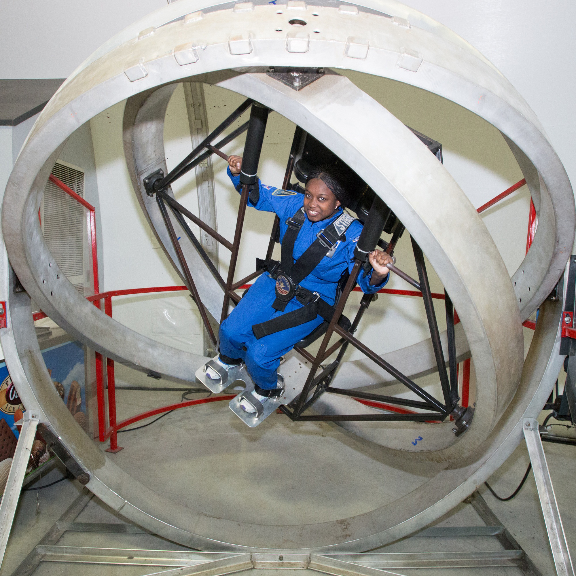 Honeywell Leadership Challenge Academy participants are able to go for a spin in simulated astronaut training exercises.