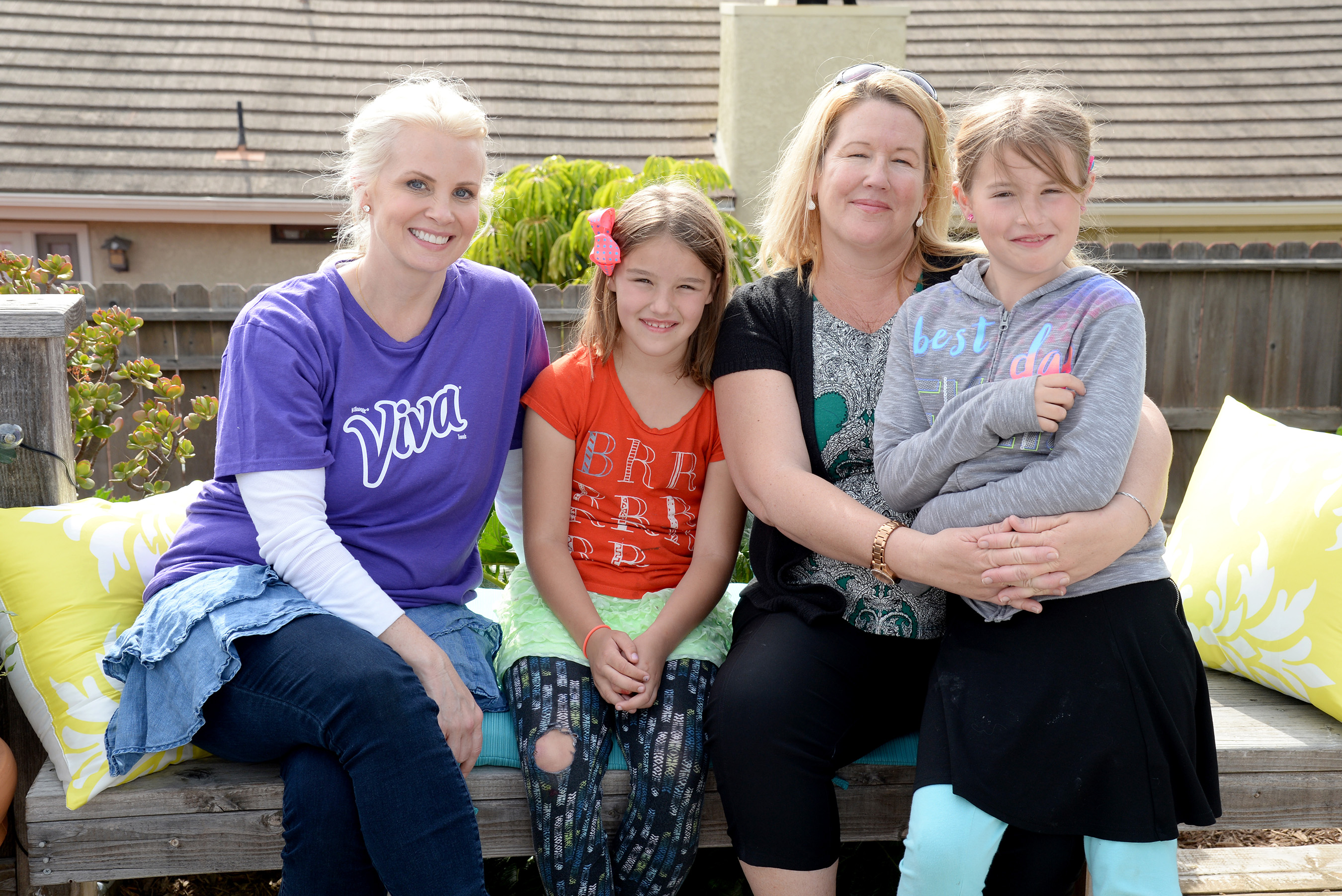 VENTURA, CALIFORNIA - APRIL 06: Actress and DIY expert Monica Potter poses with Cori Quick and her two daughters Daphne and Audrey who received a newly-rehabbed outdoor and patio space from Boys and Girls Club of Greater Ventura on April 6, 2016 in Ventura, California. (Photo by Michael Kovac/Getty Images for Viva (Kimberly-Clark))