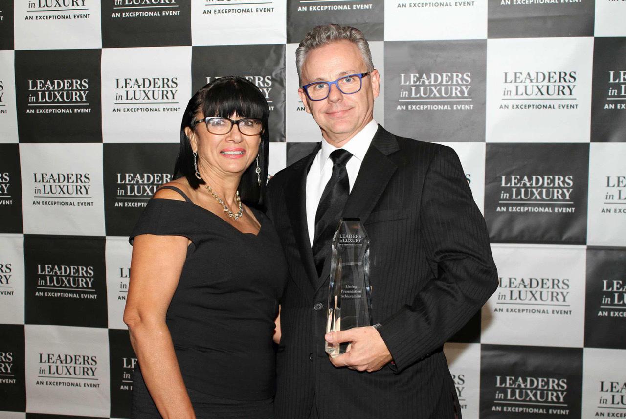 "Maverick Commins receiving the ""Best Listing Achievement"" Award"