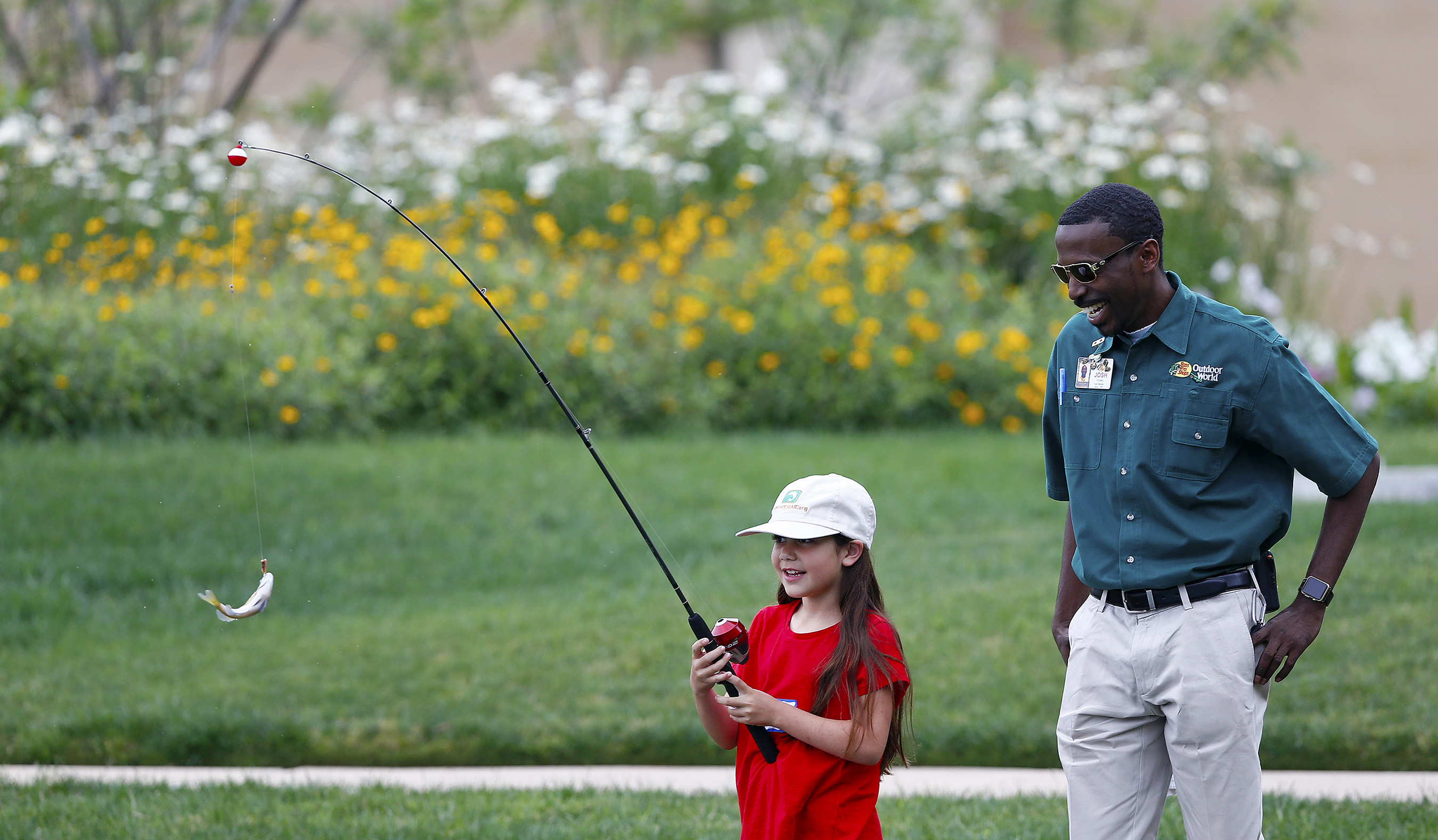 A child catches a fish during a Recreational Boating & Fishing Foundation (RBFF) event at the George Bush Presidential Library on Thursday, April 14, 2016, in College Station, Texas. RBFF is a nonprofit organization whose mission is to increase participation in recreational angling and boating, thereby protecting and restoring the nation's aquatic natural resources. (Aaron M. Sprecher/AP Images for RBFF)