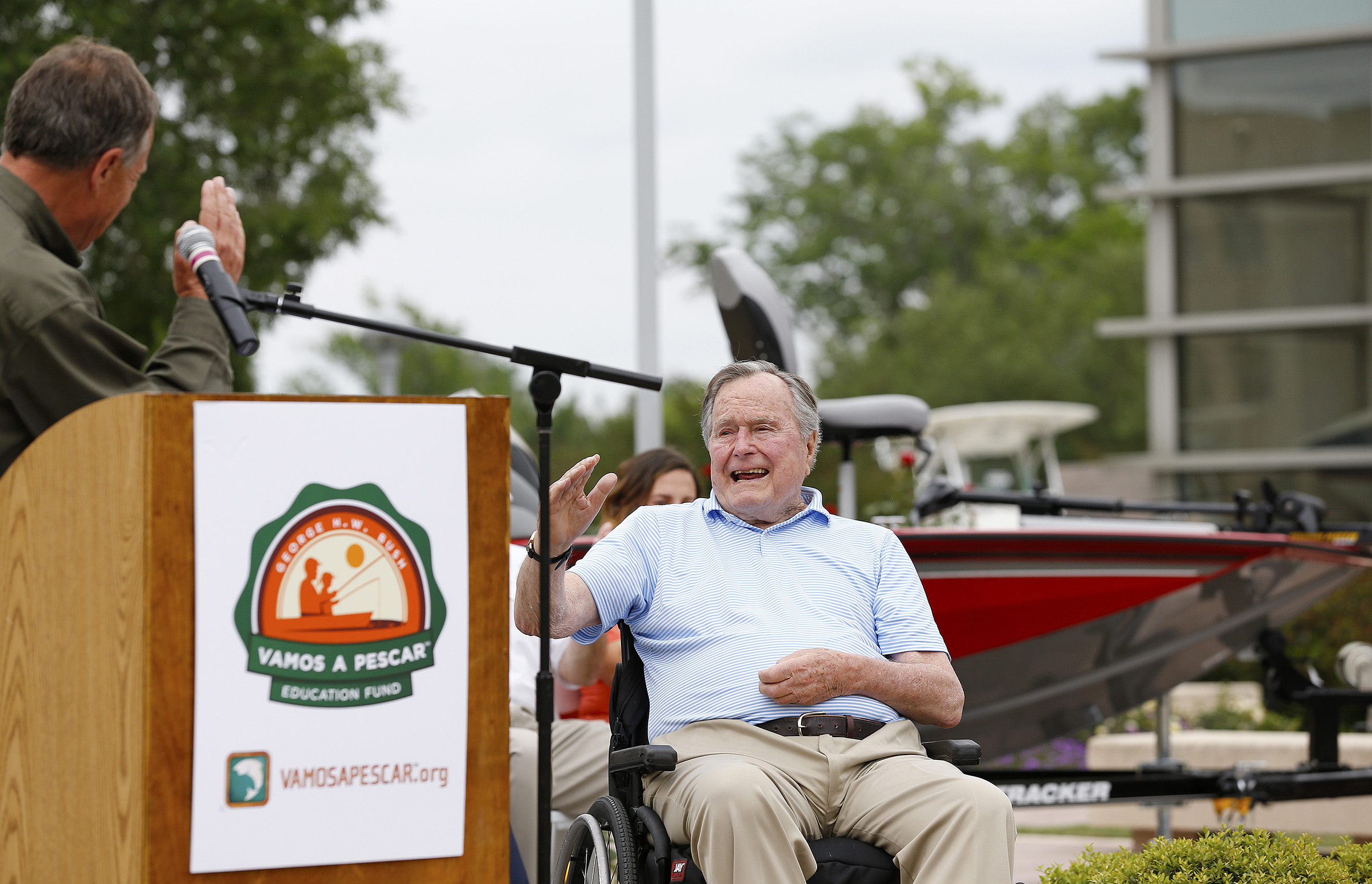 Johnny Morris, Founder and CEO of Bass Pro Shops, left, salutes President George H.W. Bush for his commitment to the fishing community during a Recreational Boating & Fishing Foundation (RBFF) event at the George Bush Presidential Library on Thursday, April 14, 2016, in College Station, Texas. RBFF is a nonprofit organization whose mission is to increase participation in recreational angling and boating, thereby protecting and restoring the nation's aquatic natural resources. (Aaron M. Sprecher/AP Images for RBFF)