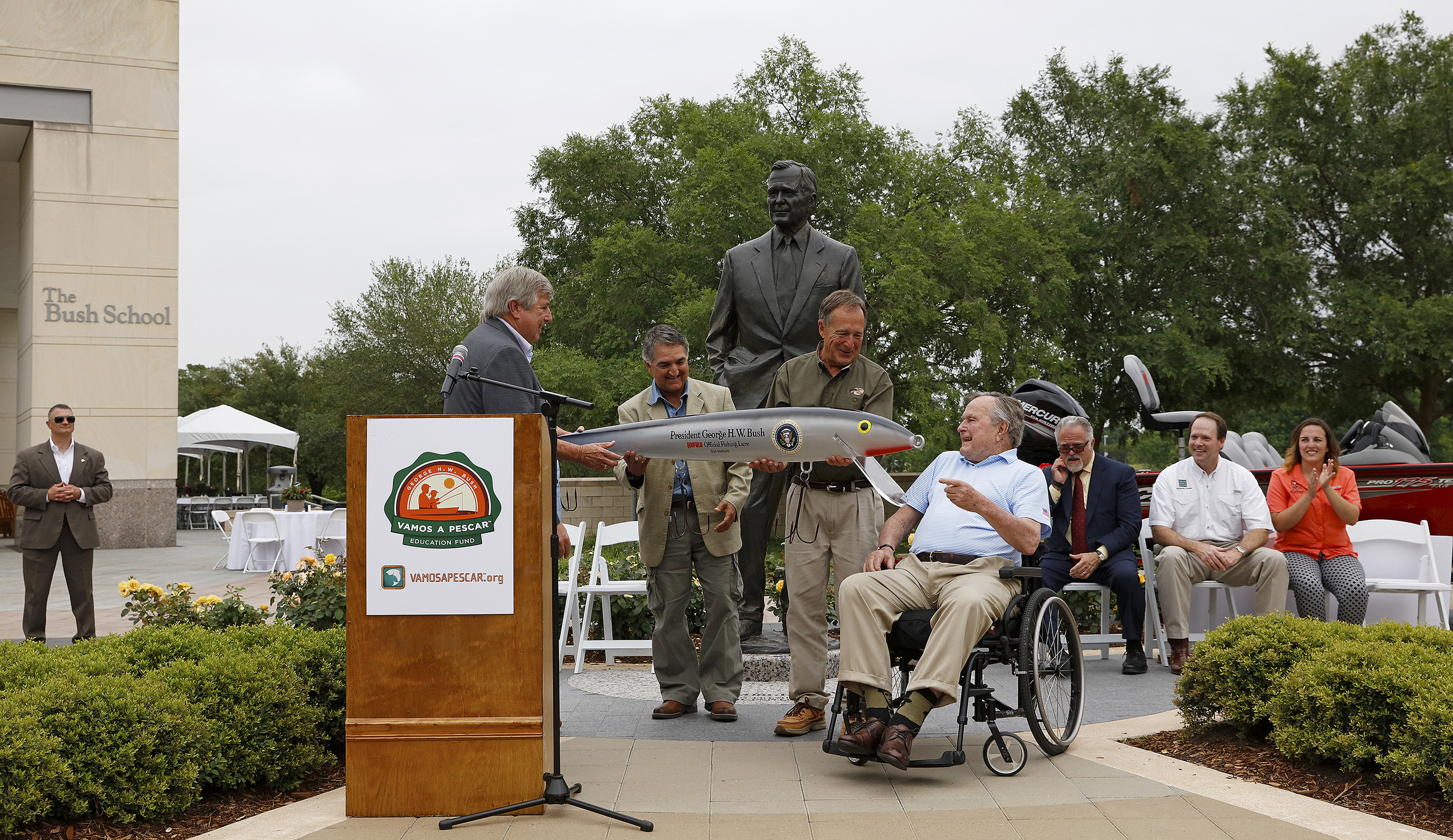 President George H.W. Bush is presented with a commemorative lure during a Recreational Boating & Fishing Foundation (RBFF) event at the George Bush Presidential Library on Thursday, April 14, 2016, in College Station, Texas. RBFF is a nonprofit organization whose mission is to increase participation in recreational angling and boating, thereby protecting and restoring the nation's aquatic natural resources. (Aaron M. Sprecher/AP Images for RBFF)