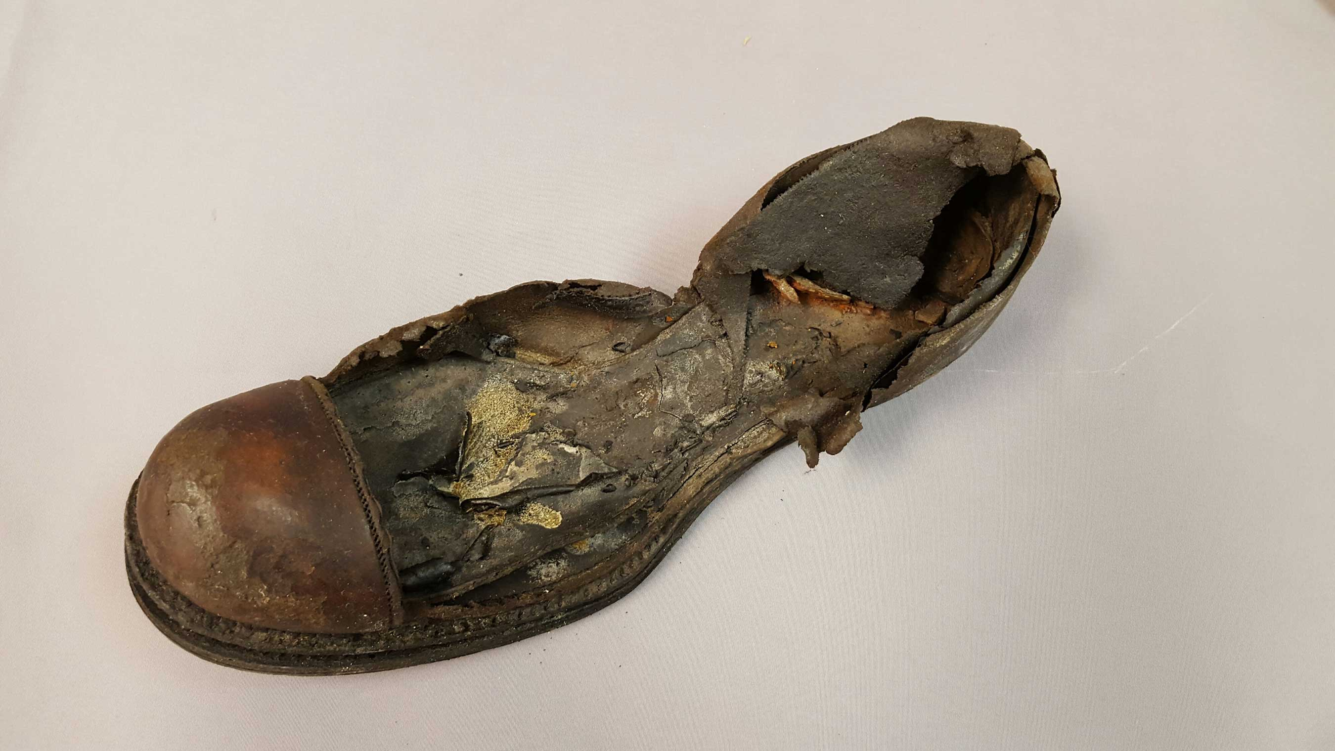 This men's leather shoe fragment consists of the welt, top cap and partial quarter with the insole. This shoe has never been previously exhibited due to its fragile condition. (Credit Premier Exhibitions)
