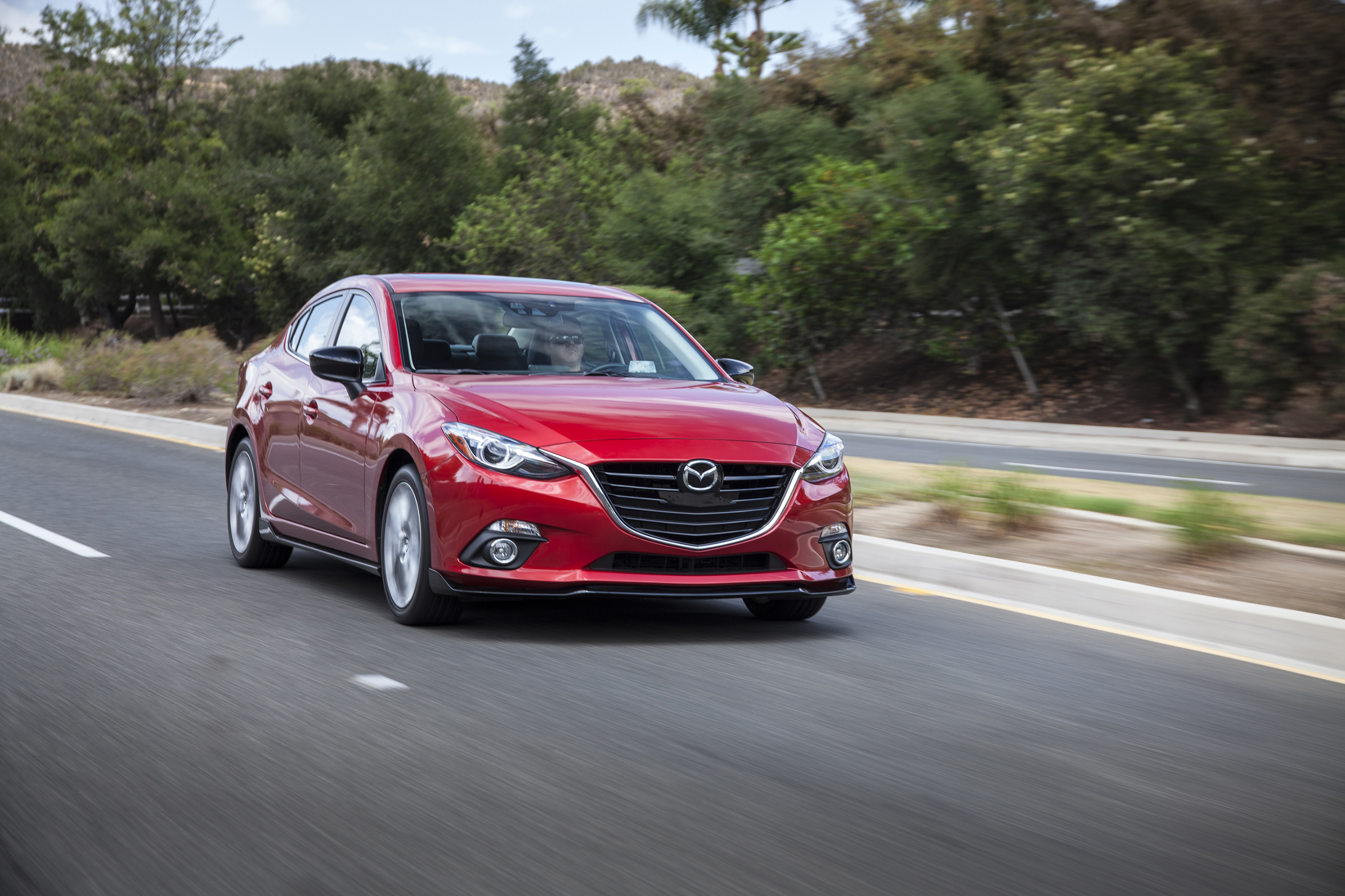 KBB.com 10 Coolest Cars: Gorgeous and sporty outside, as well as inside, the Mazda3 has been named one of our 10 Coolest Cars Under $18,000 every year of its existence.
