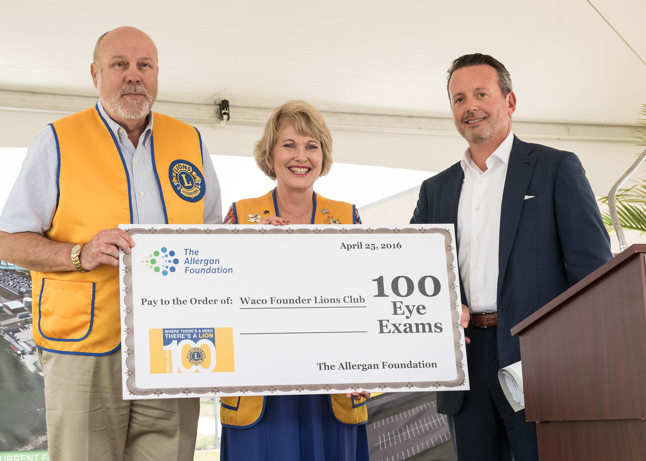 Allergan President & CEO Brent Saunders presents a donation of 100 eye exams to Waco Lions Club President Buck Rogers and Past President and Vision Screening Chair Louise Ann Powell. The donation, by the Allergan Foundation, is in recognition of Lions Club International's 100 year anniversary The donation will allow the Waco Founders Lions Club to initiate a pilot project coordinating with local eye care professionals to support eye exams for those in need in the Waco community.