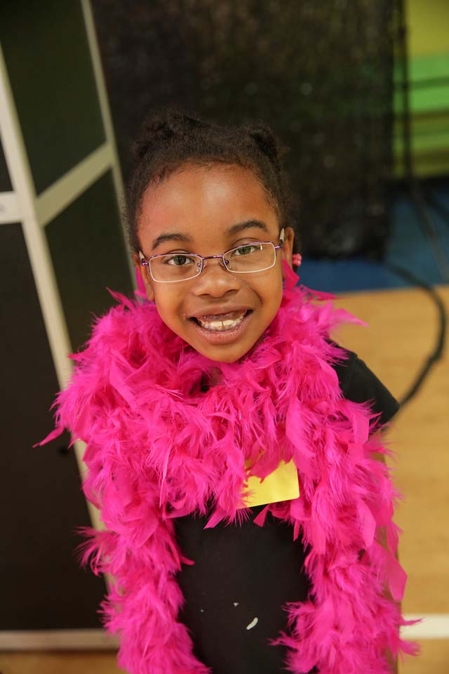 Yazmeen T. takes a moment to smile for the camera before showing off her new frames in the photo booth.