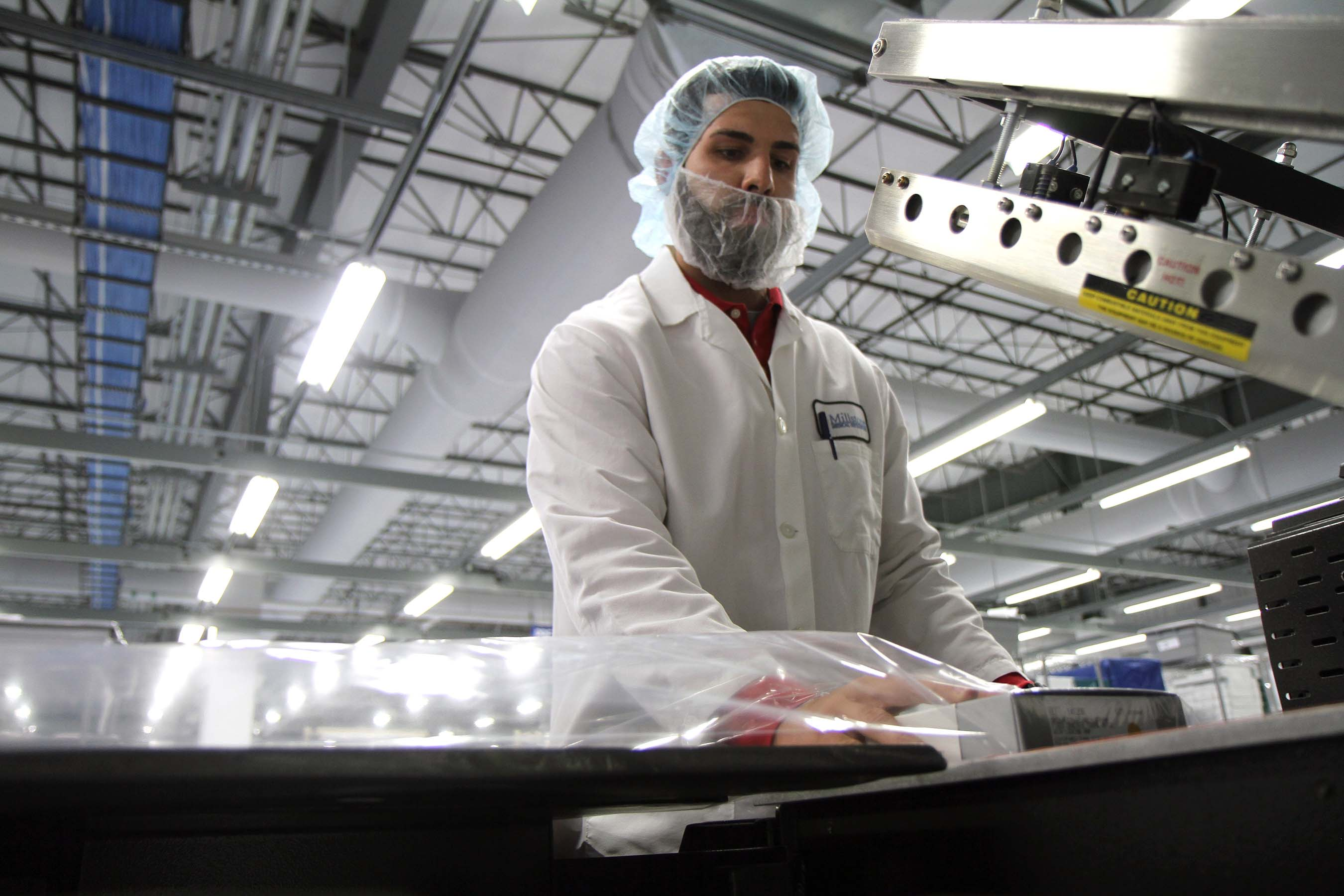 A look at a Millstone Medical employee in their clean packaging room