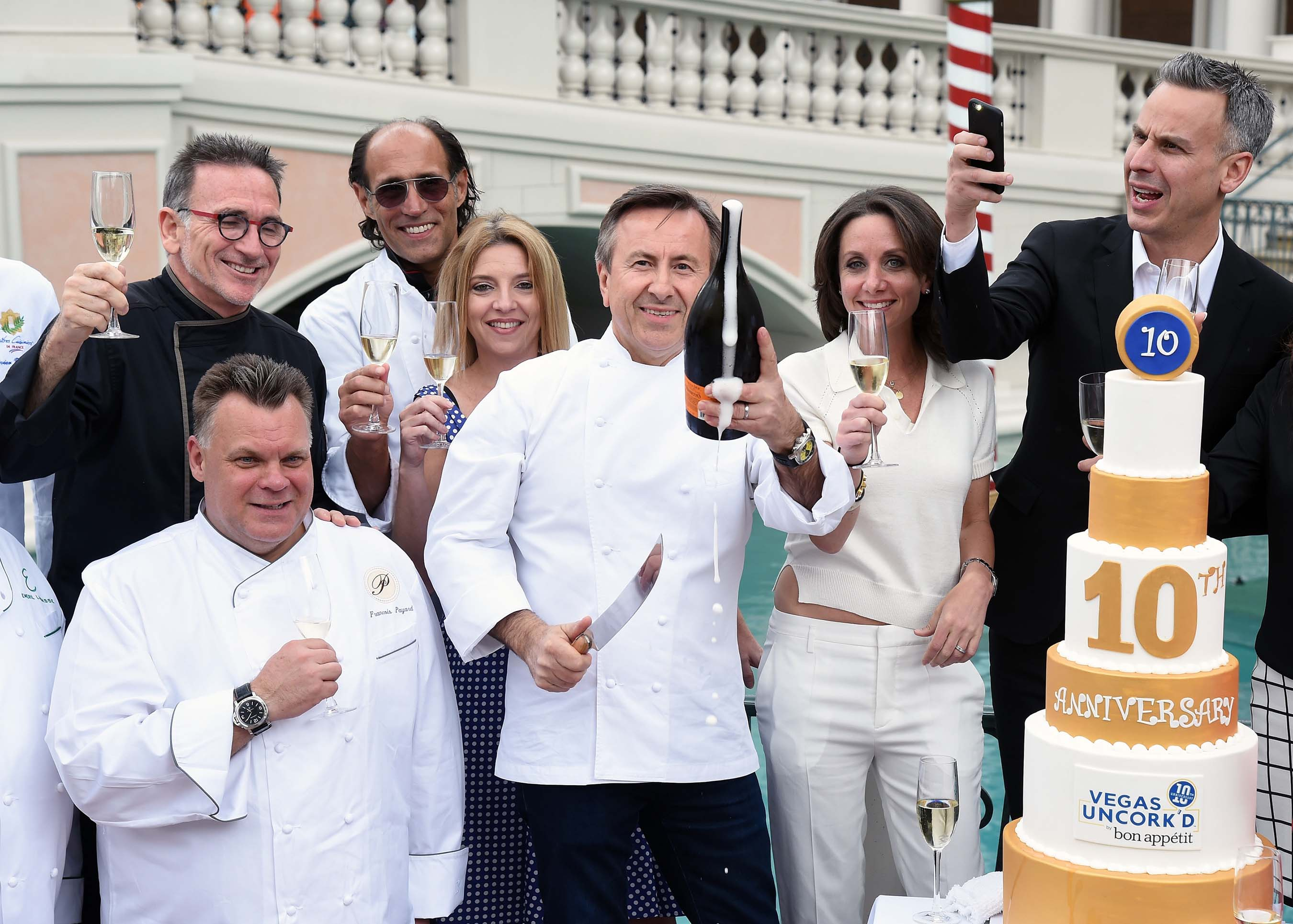 Chef Daniel Boulud toasts to the 10th anniversary at Saber Off during Vegas Uncork'd by Bon Appétit presented by Chase Sapphire Preferred (Photo by Ethan Miller/Getty Images for Vegas Uncork'd)