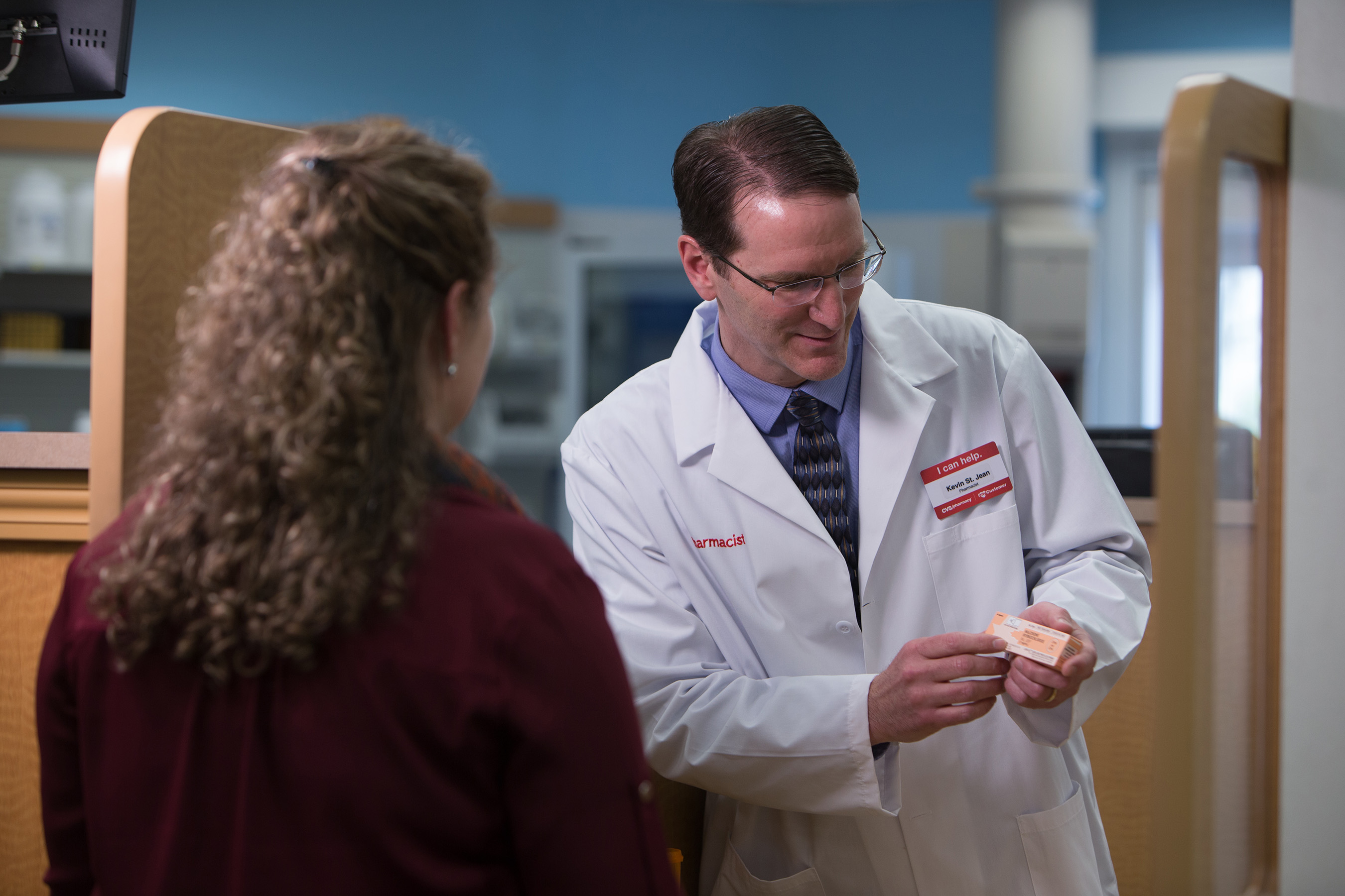 A CVS pharmacist provides information about how to identify an opioid overdose and properly administer naloxone when dispensing the medication