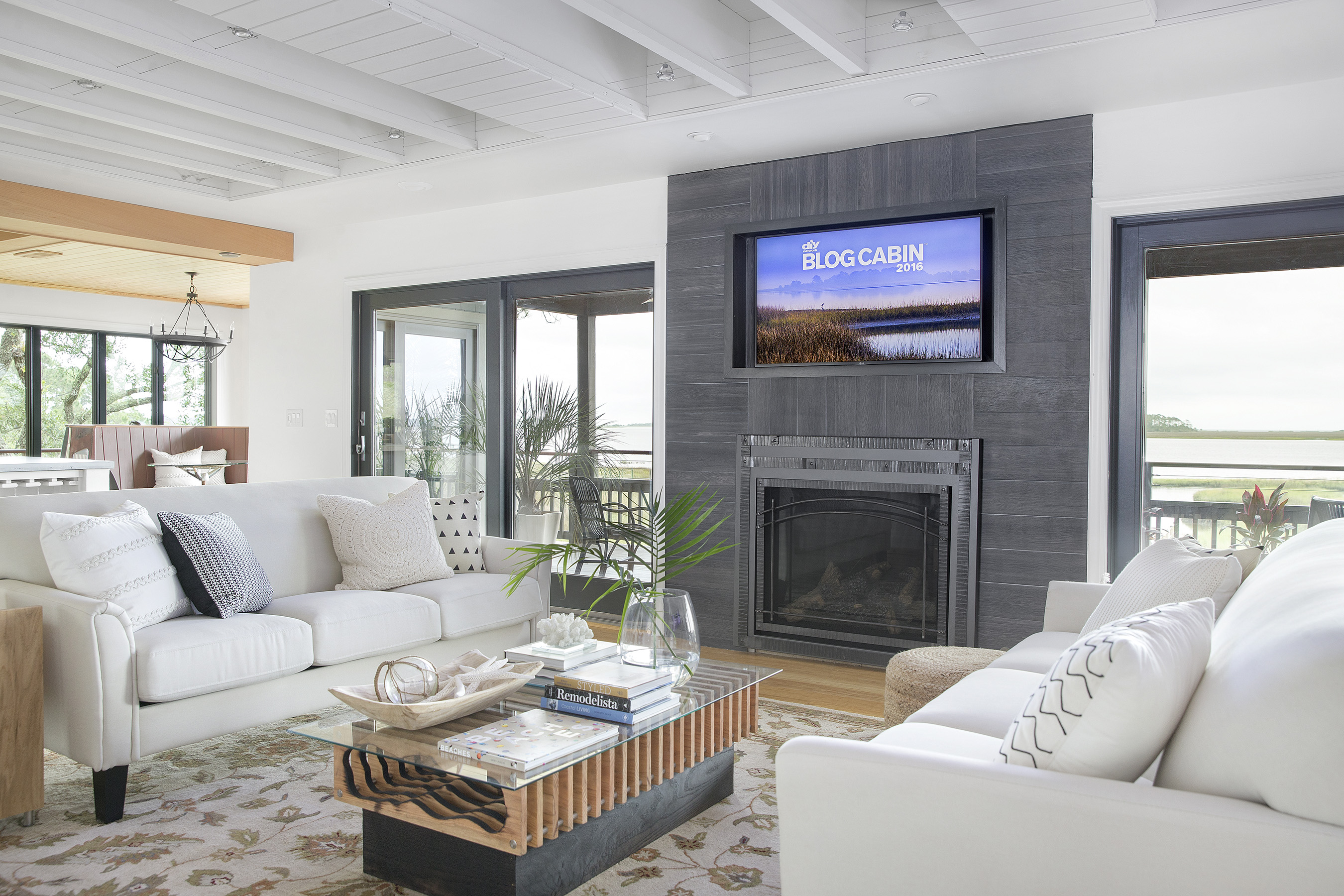 In the DIY Network Blog Cabin 2016 living area, the view takes center stage outside. Inside, a giant saltwater fish tank adds life to the space.