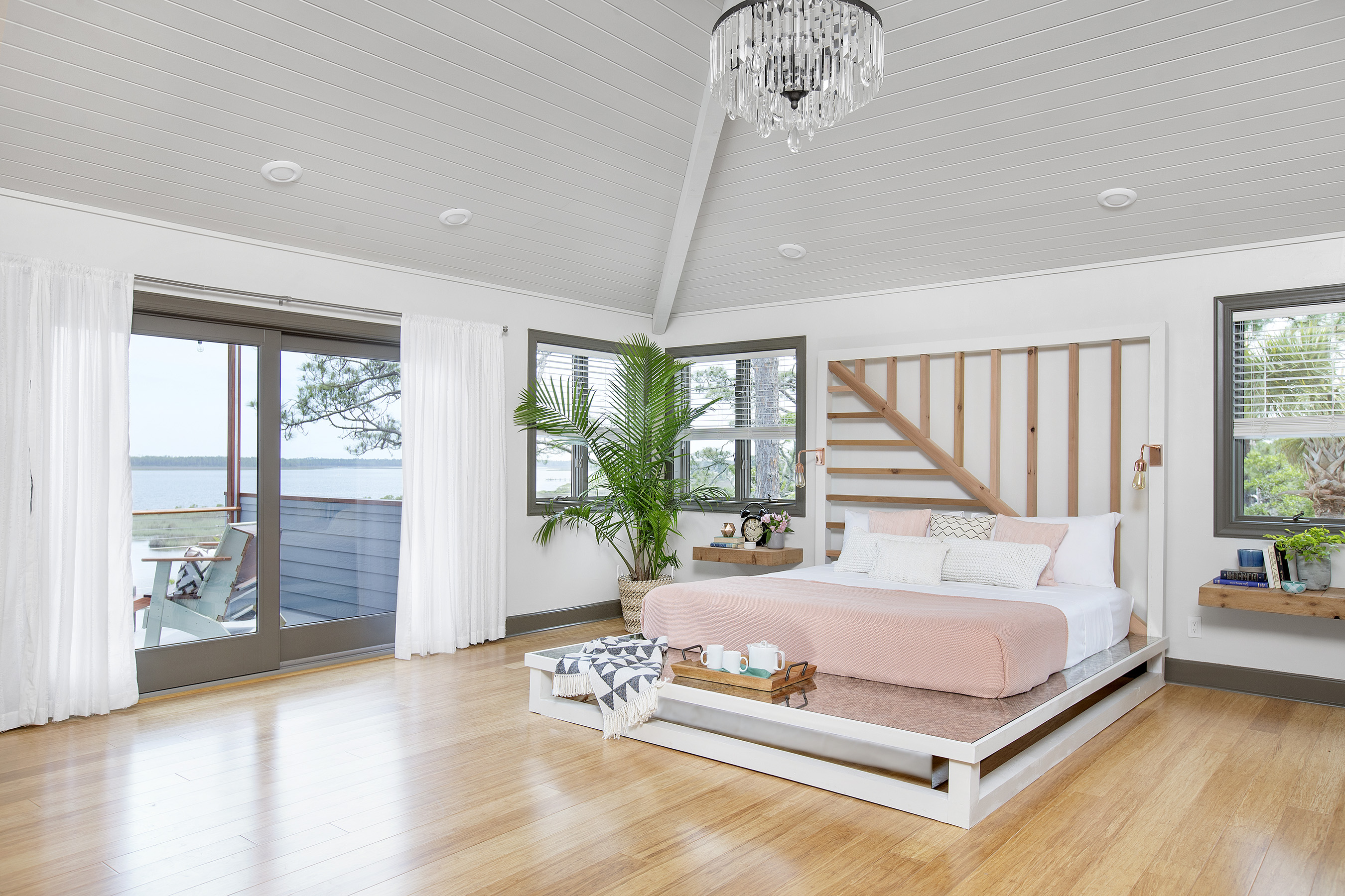 At the DIY Network Blog Cabin 2016, the upstairs master bedroom has a platform bed, custom headboard and roomy spa-like bath all awash in neutral colors exuding tranquil vibes.