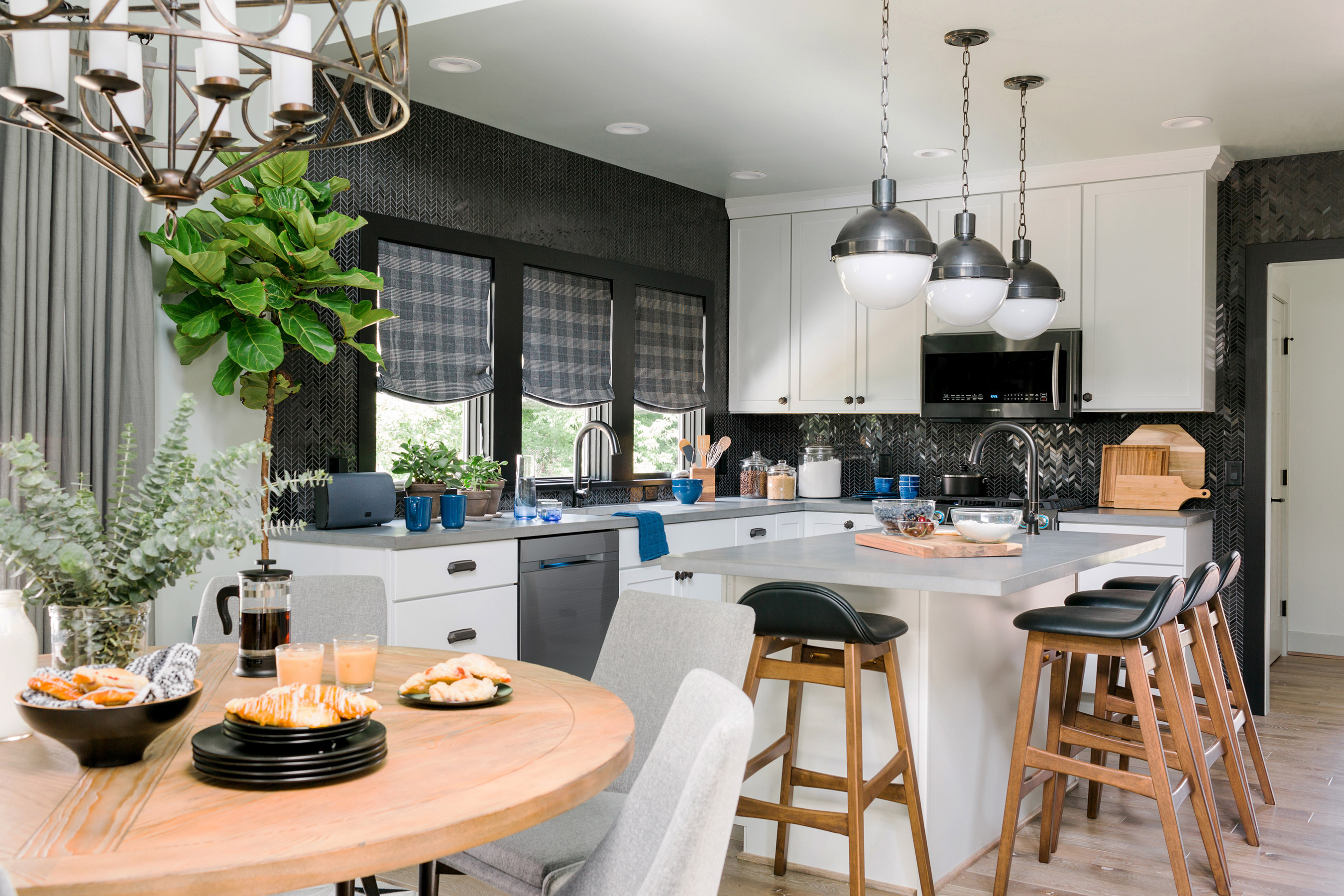 The kitchen of the HGTV Urban Oasis 2016 features a bold black-and white color scheme, a suite of high-tech appliances and a trio of pendant lights that add a modern, industrial feel.